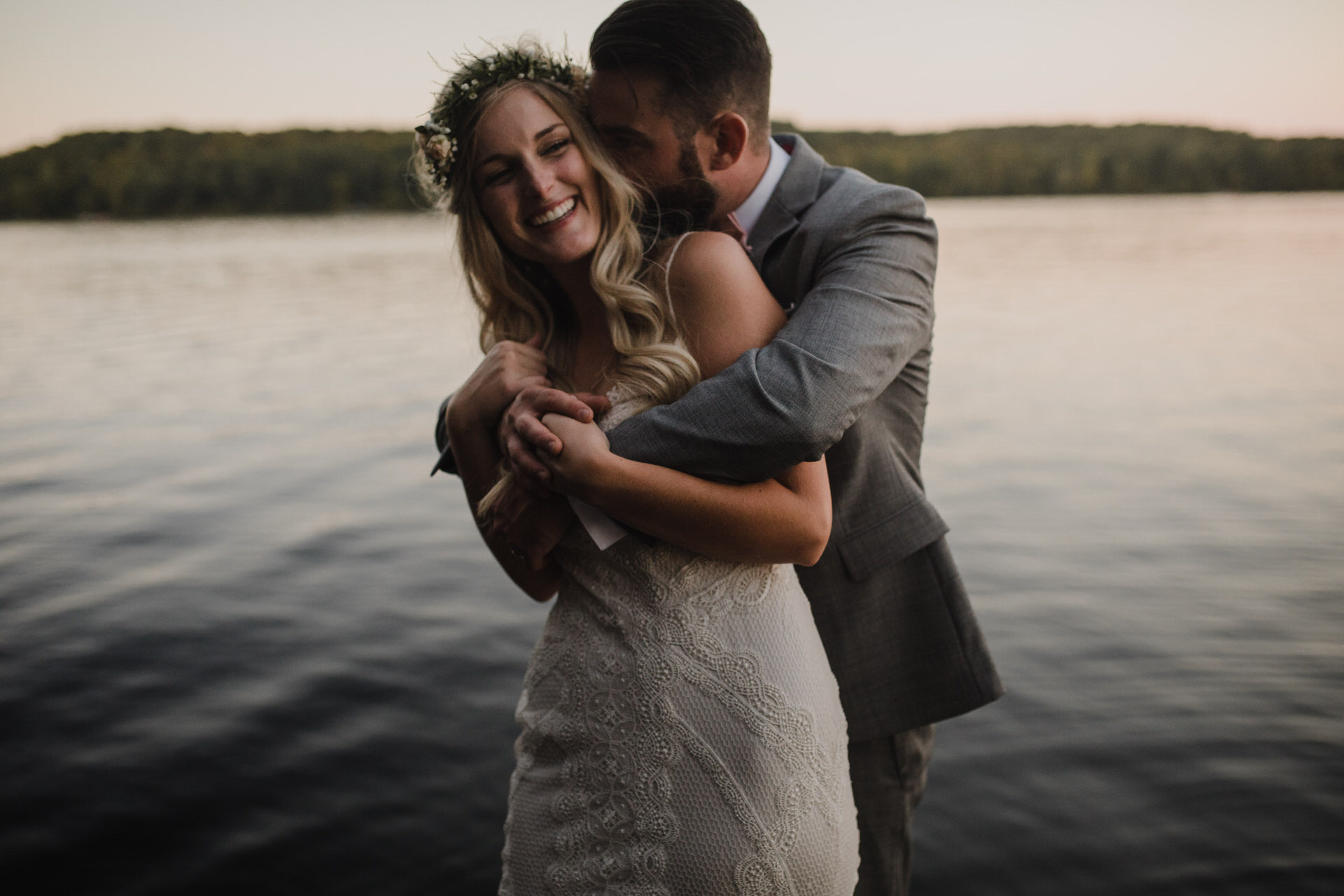 Muskoka Wedding - sneaky kisses on the dock