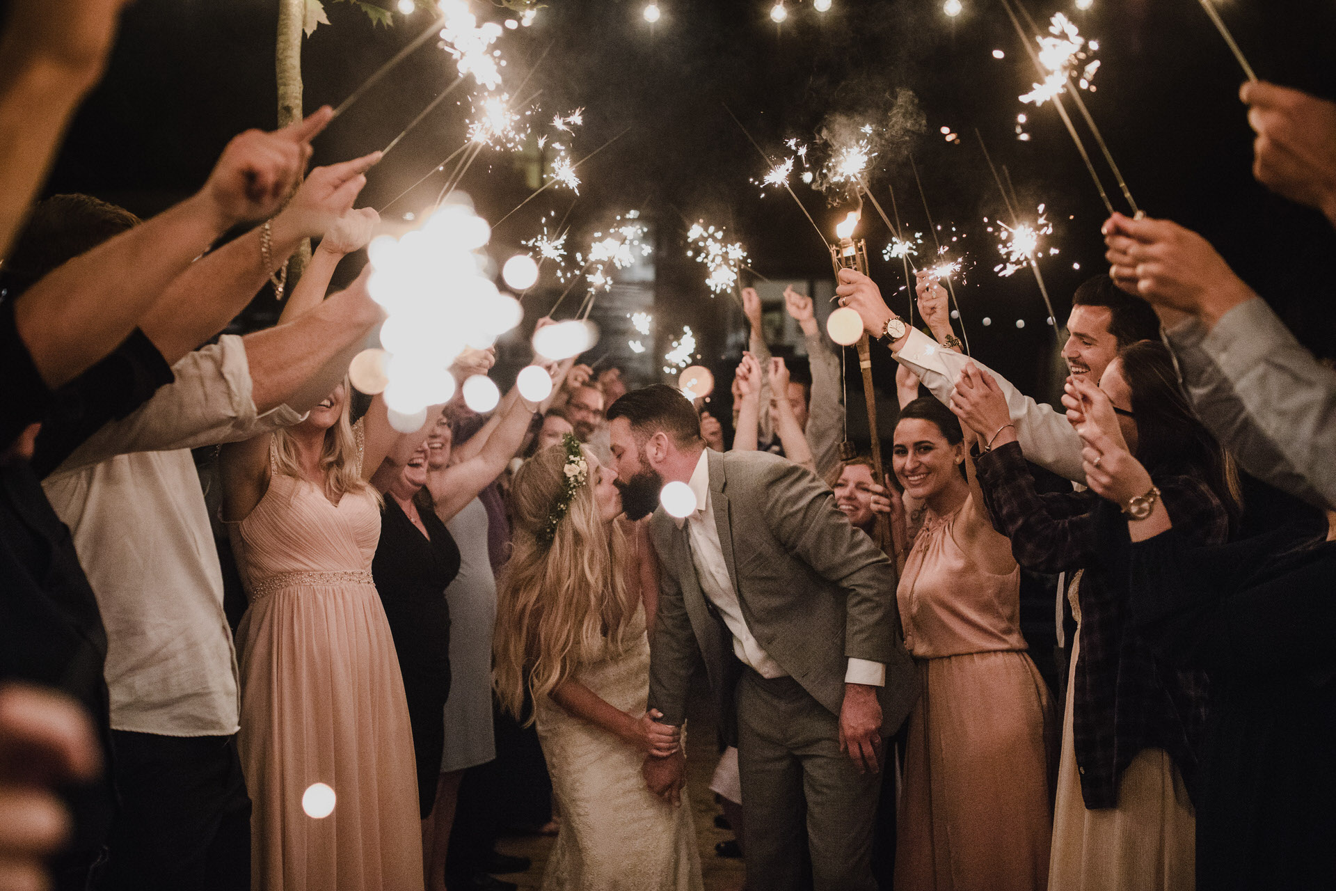 Muskoka Wedding - kissing under the sparklers
