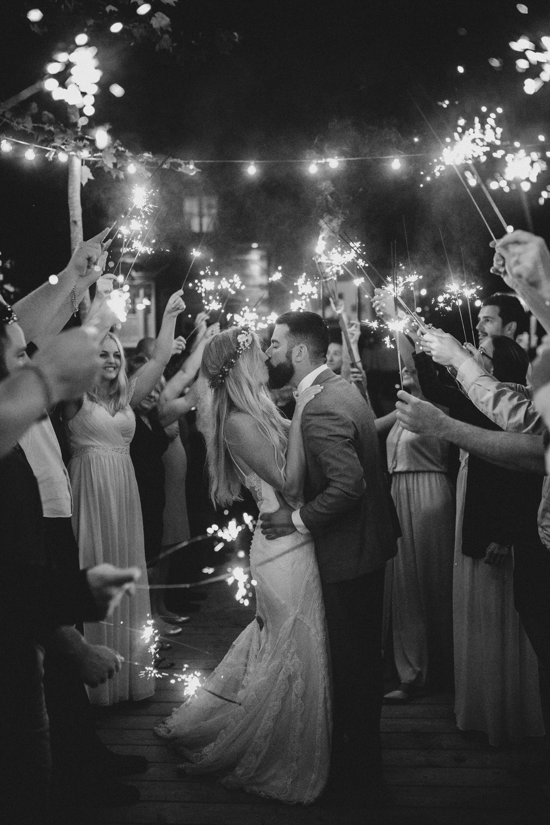 Muskoka Wedding - kissing and sparklers