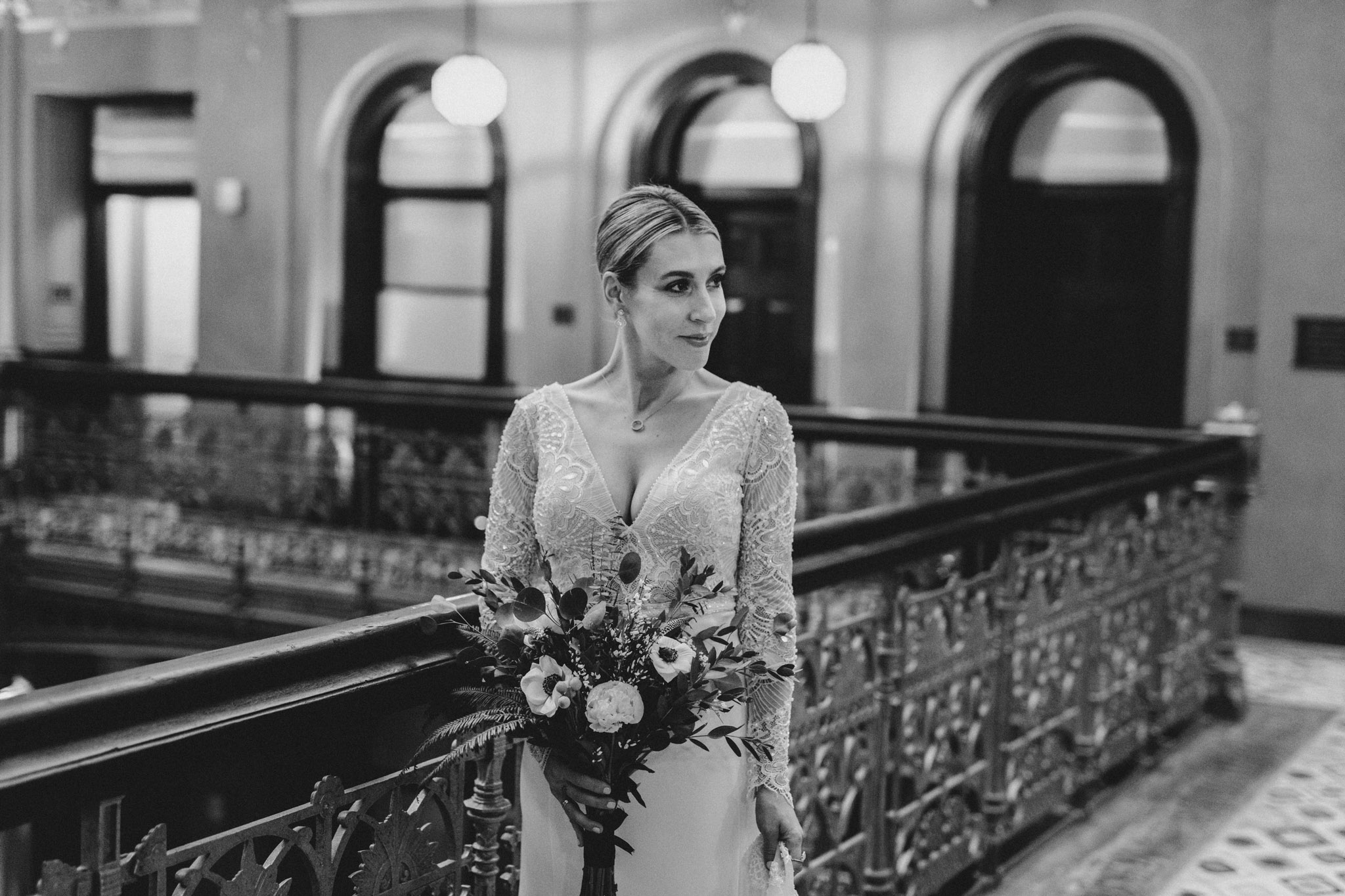 Downtown NYC Wedding - The Beekman Hotel - bride in the balcony