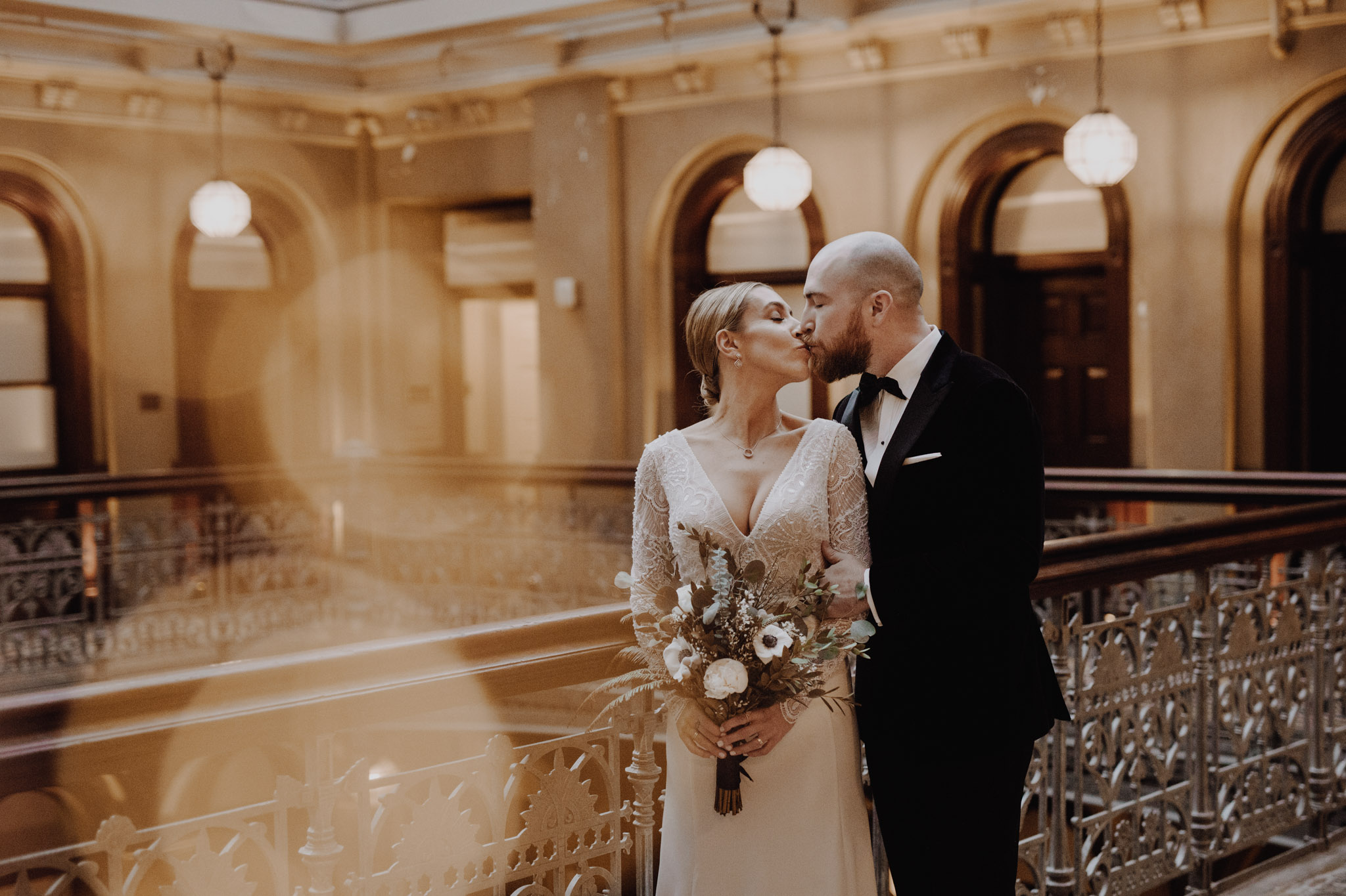 Downtown NYC Wedding - The Beekman Hotel - kissing on the balcony