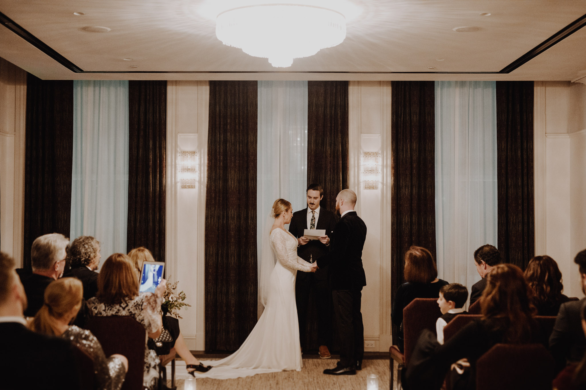 Downtown NYC Wedding - The Beekman Hotel - bride and groom at the alter