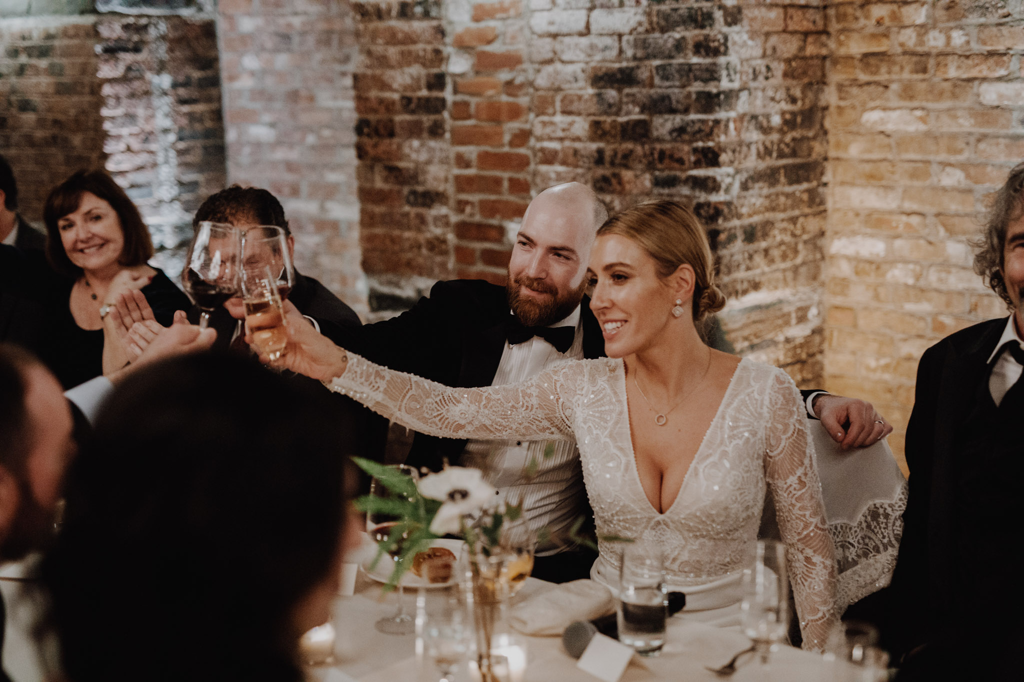 Downtown NYC Wedding - The Beekman Hotel - bride and groom cheers