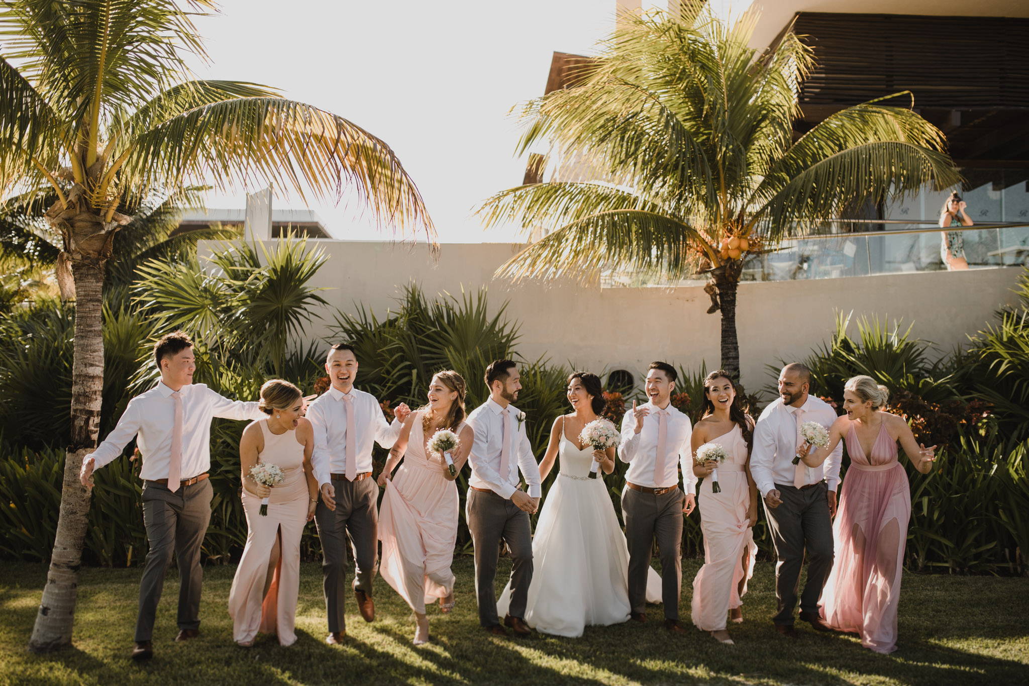 Cancun Mexico Wedding - wedding party with palm trees
