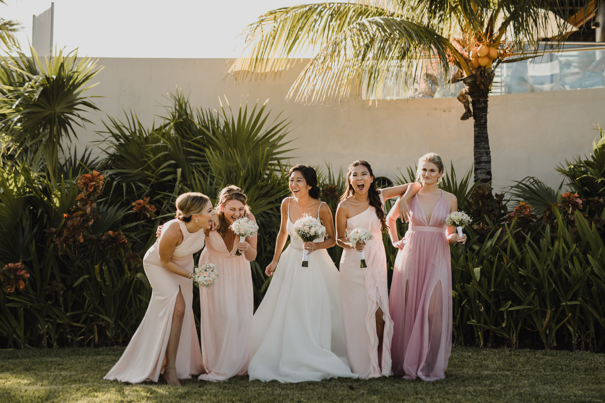 Cancun Mexico Wedding - bridal party laughing