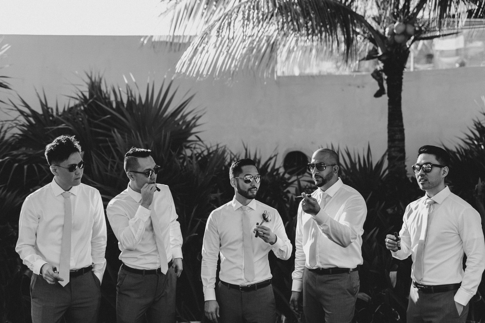 Cancun Mexico Wedding - groomsmen with cigars