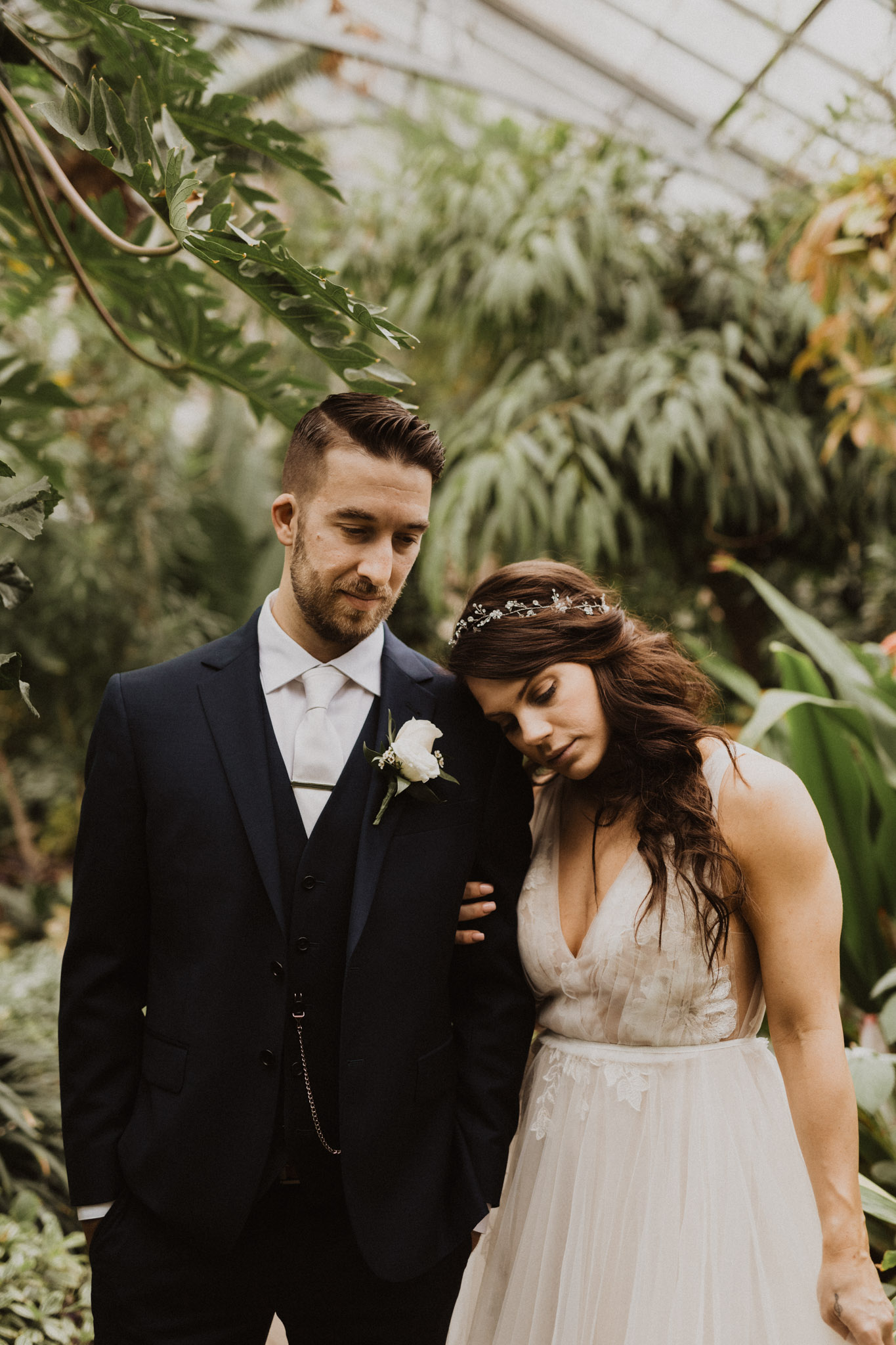 Greenhouse Elopement Allan Gardens Toronto - bride and groom embrace