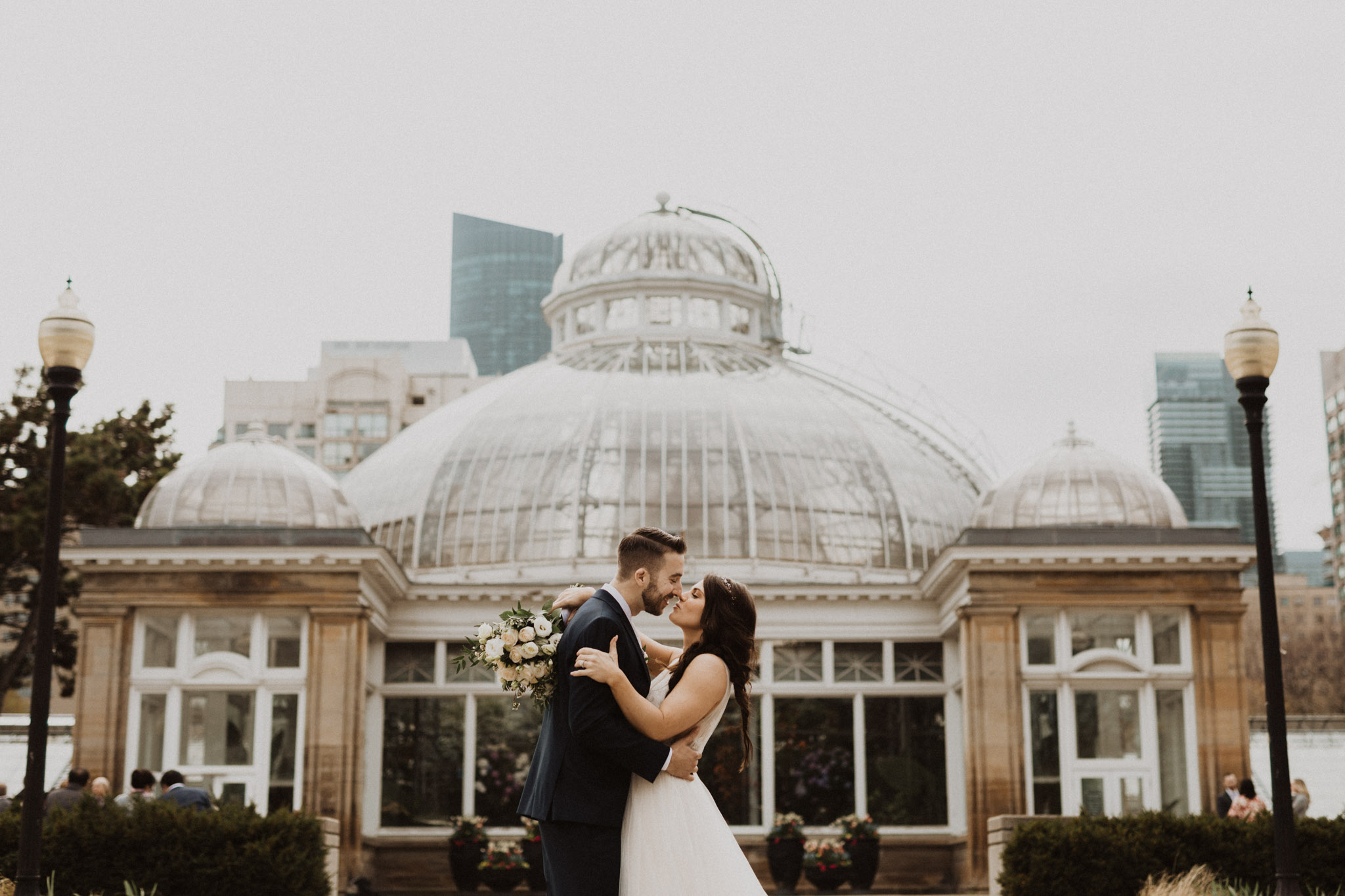 Greenhouse Elopement Allan Gardens Toronto - bride and groom kiss in front of greenhouse