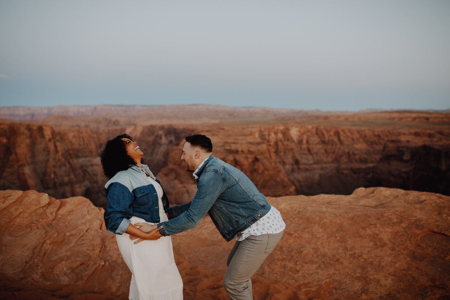 Horseshoe Bend Engagement - goofing around in jean jackets near the canyon