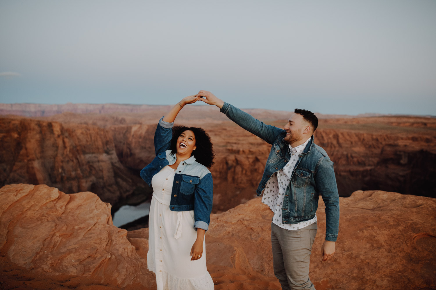 Horseshoe Bend Engagement - couple dancing near Antelope Canyon in Arizona