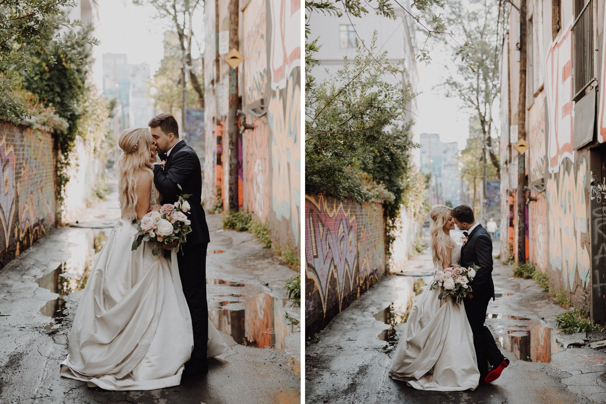 Rainy day kiss at The Burroughes Wedding. Love By Lynzie. Wedding Photographer Jennifer See Studios.