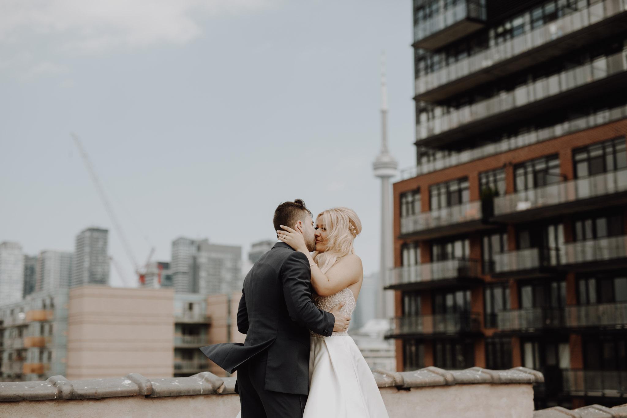 Rooftop kisses. Love By Lynzie. Wedding Photographer Jennifer See Studios.