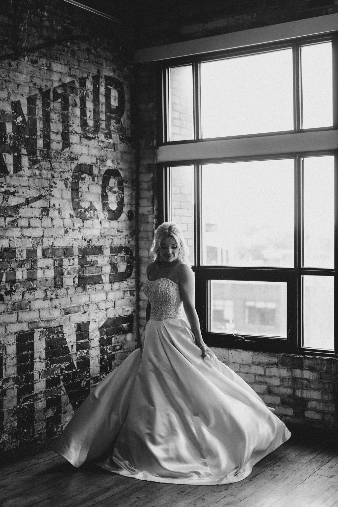 Swishing the dress at The Burroughes Wedding. Love By Lynzie. Wedding Photographer Jennifer See Studios.