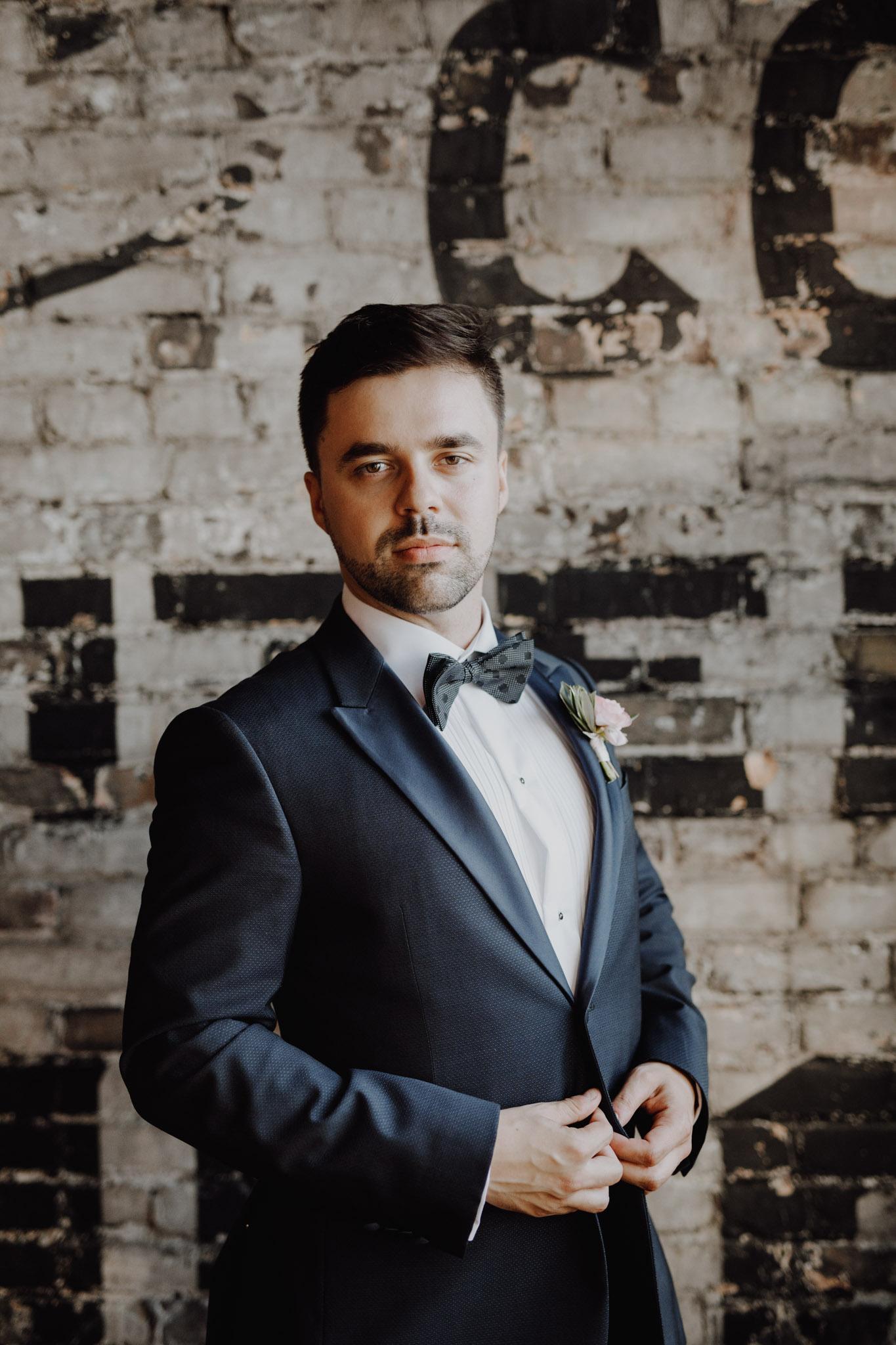 Dapper groom at The Burroughes Wedding. Love By Lynzie. Wedding Photographer Jennifer See Studios.