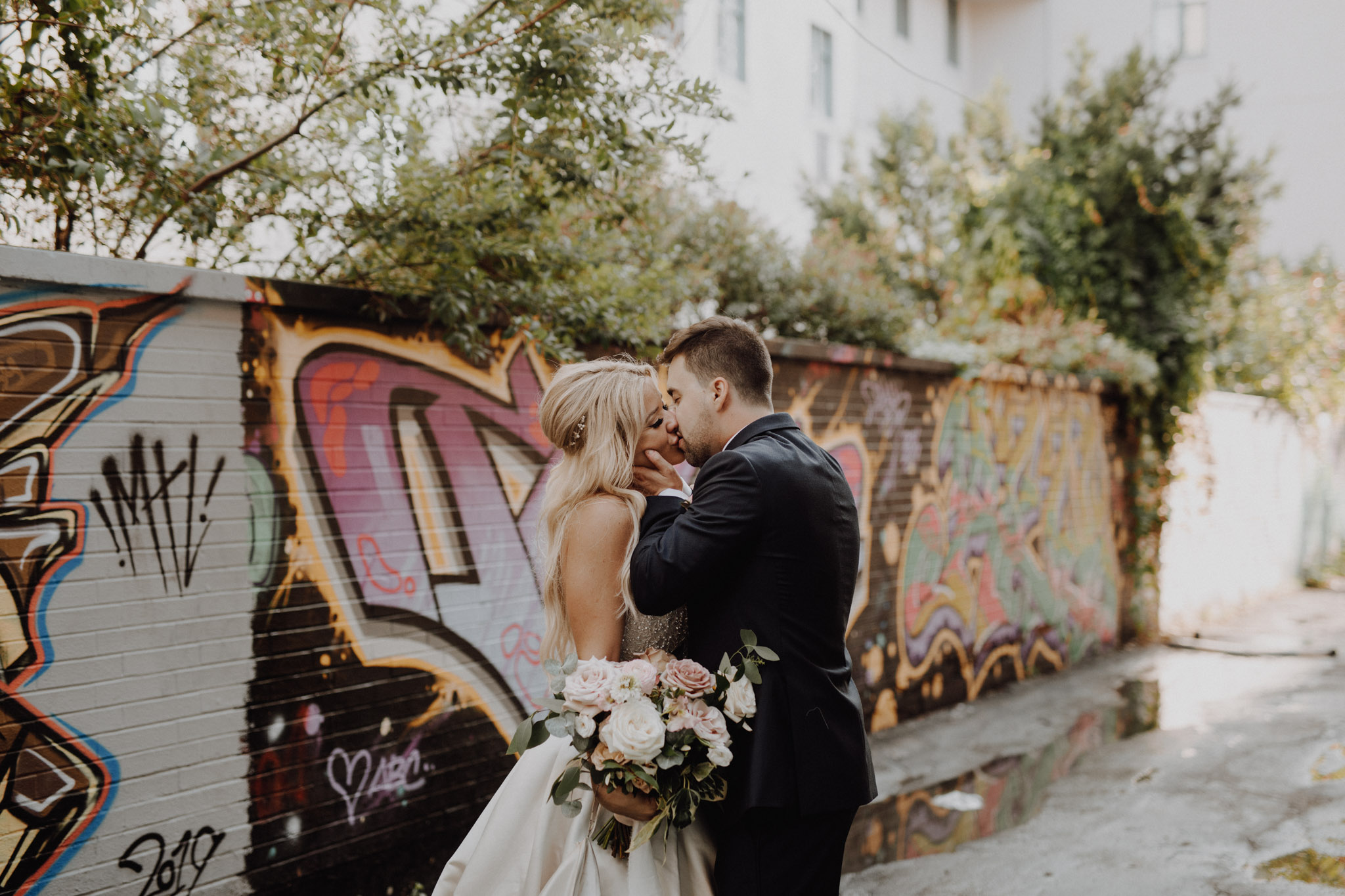 Graffiti Alley kisses at The Burroughes Wedding. Love By Lynzie. Wedding Photographer Jennifer See Studios.