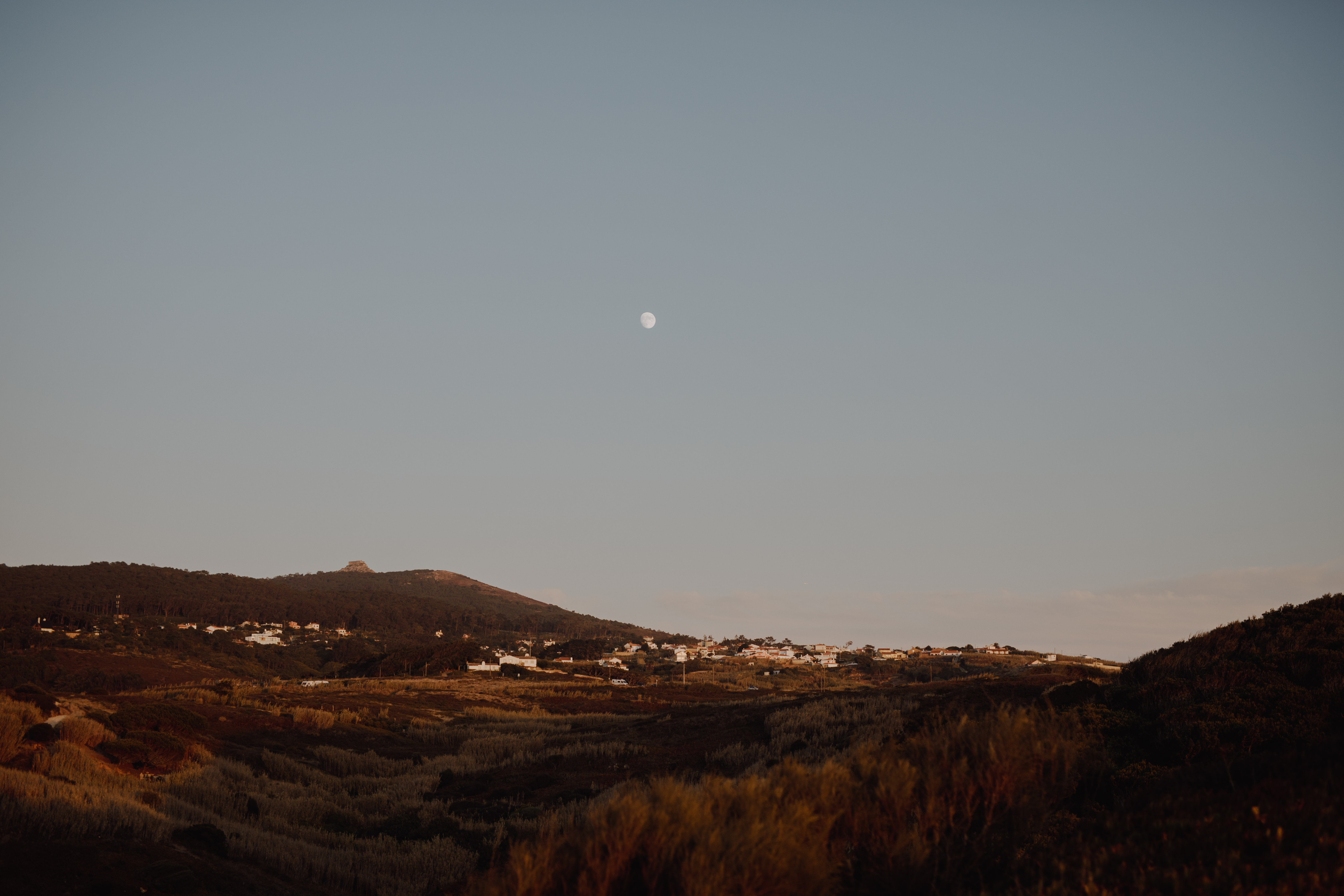 Destination Elopement Photographer - Connection Session in Portugal - the moon over the countryside