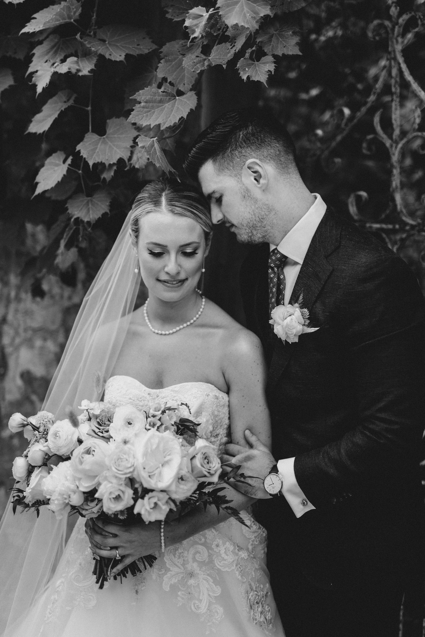 Elora Mill Wedding - bride and groom portrait with greenery