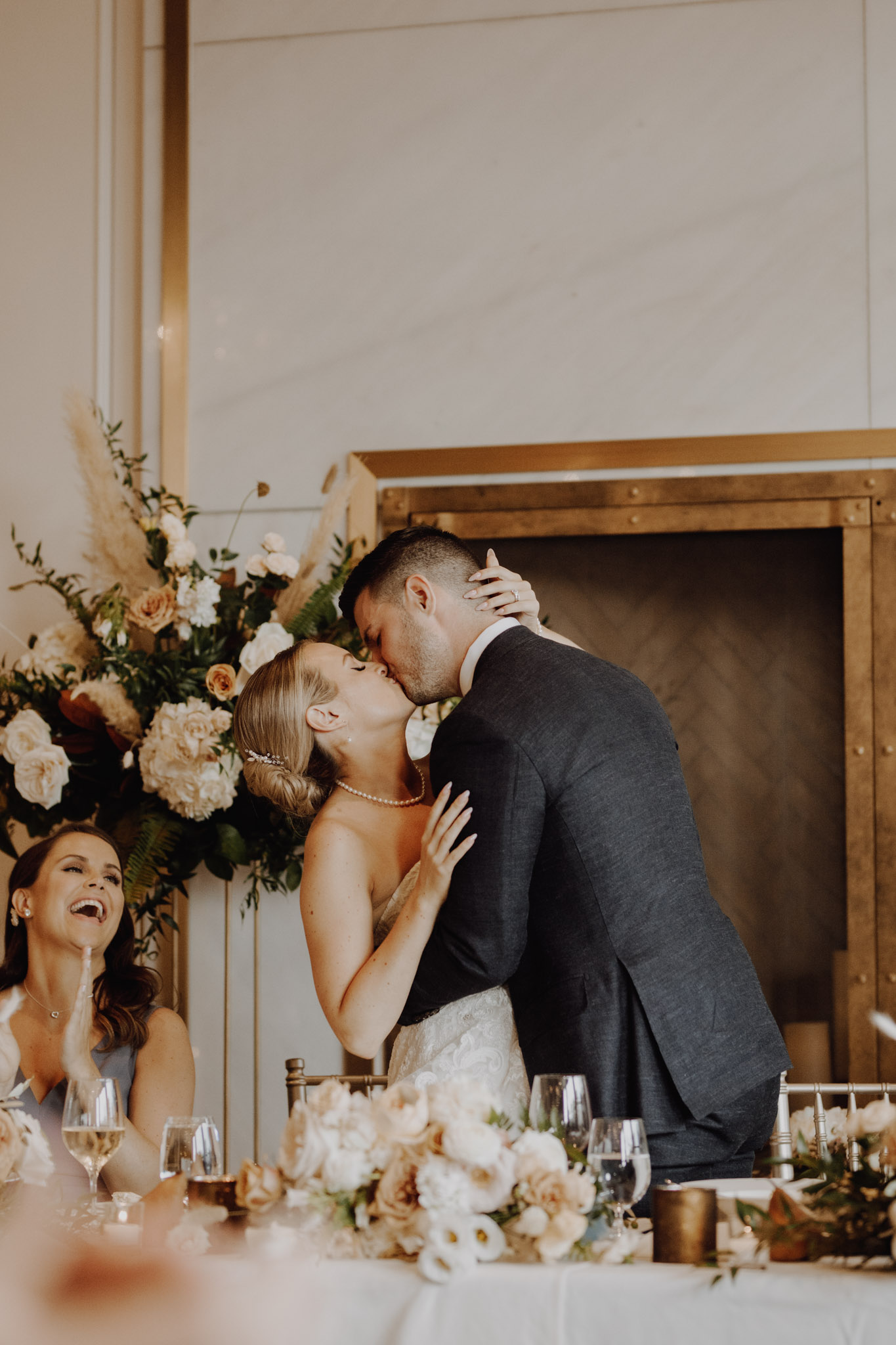 Elora Mill Wedding - bride and groom kiss at the table