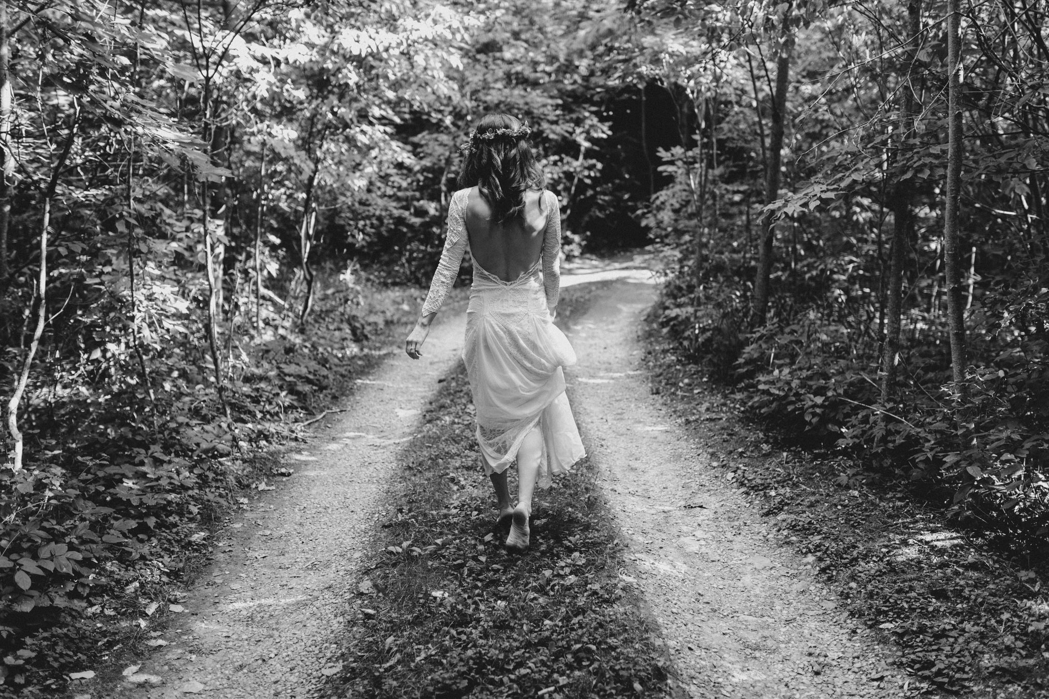 Outdoor Camp Wedding - bride on wooded path