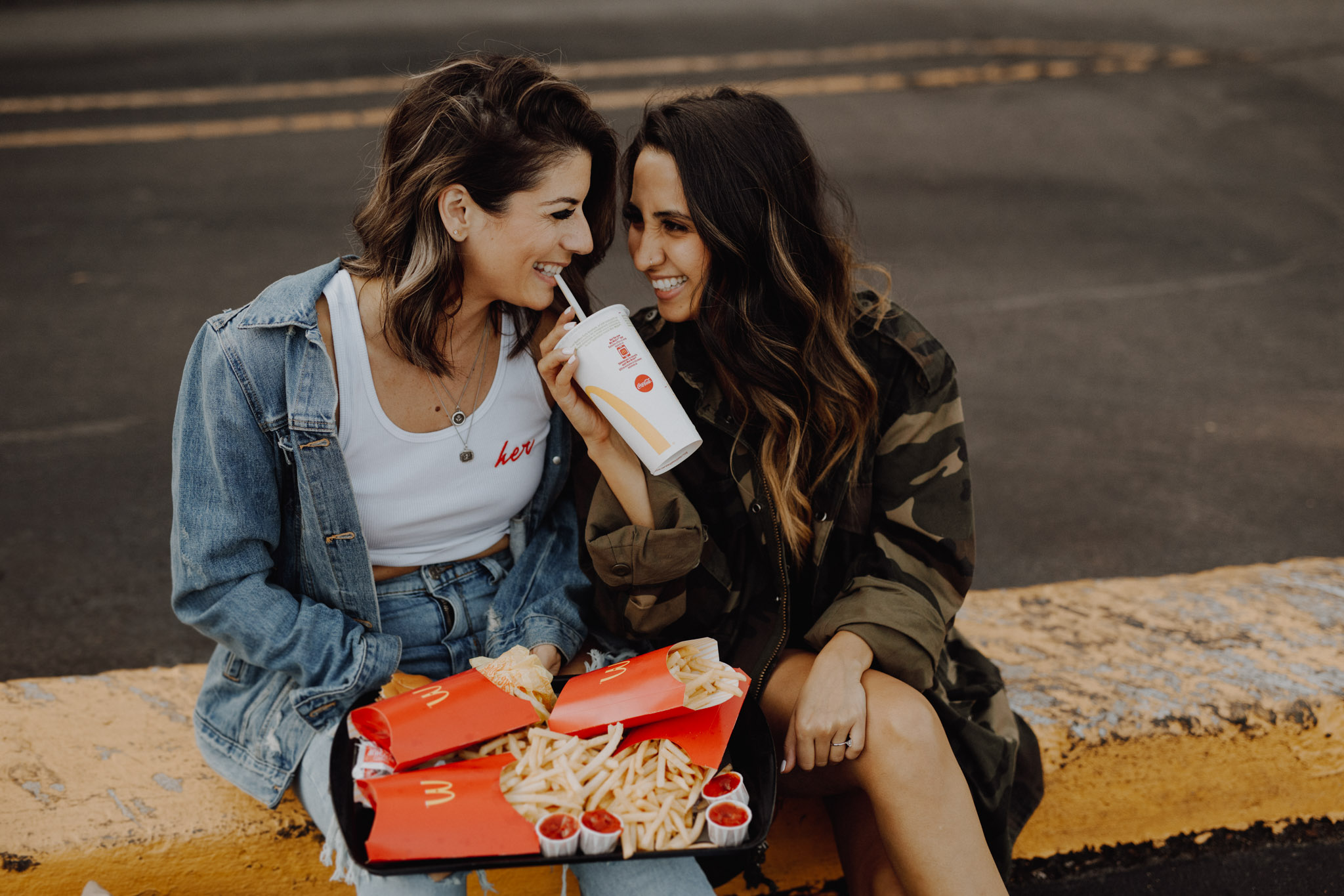 Mcdonalds engagement session - a pile of fries, a soft drink and women