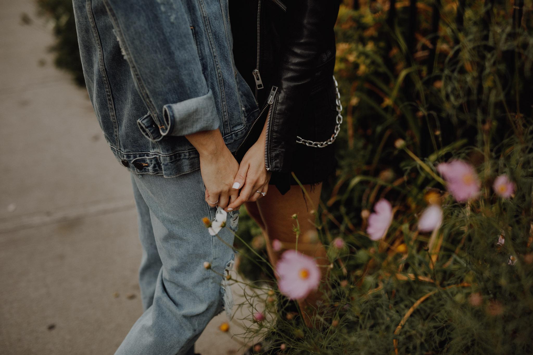 Mcdonalds engagement session - holding hands near flowers