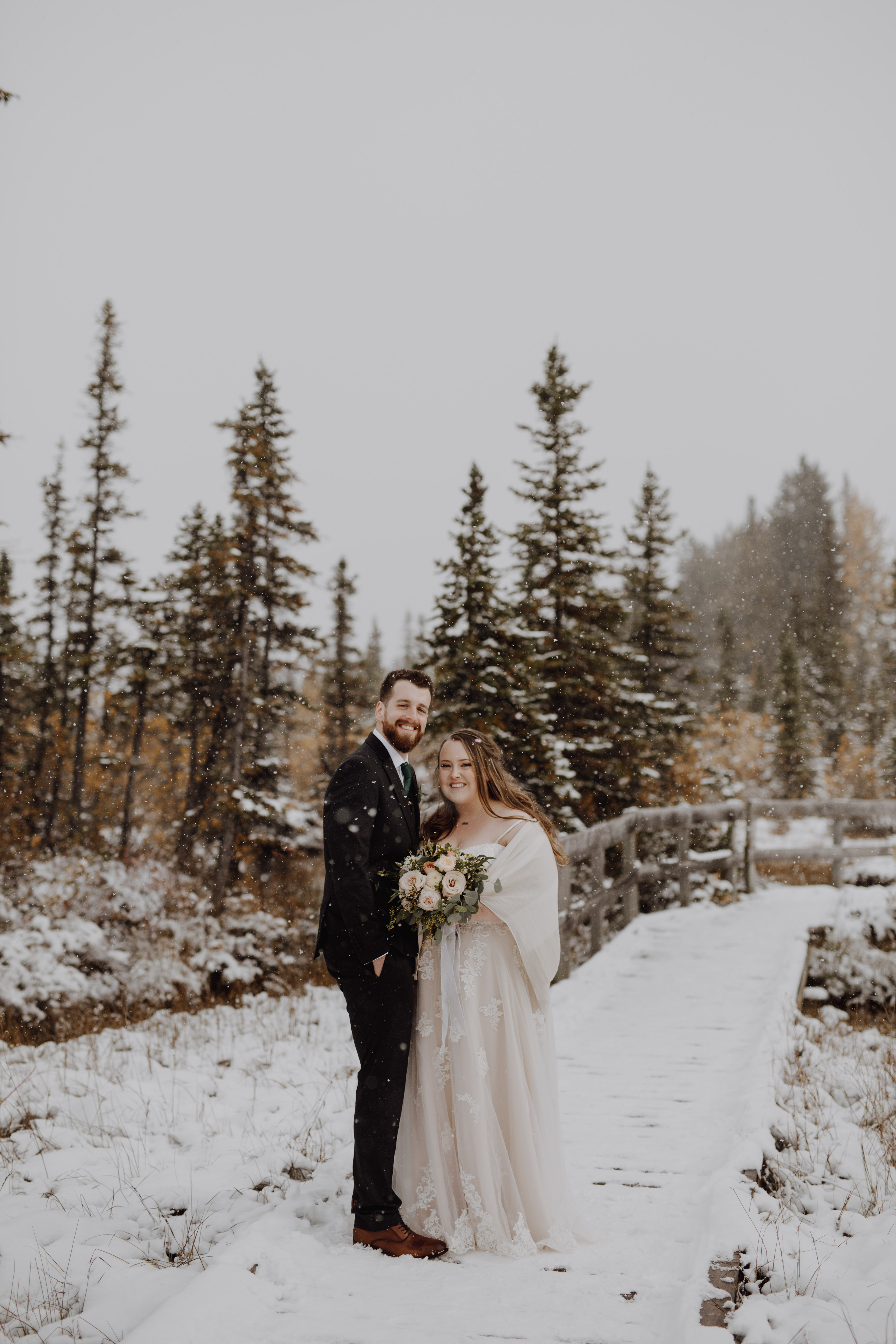 Banff Wedding - bride and groom on a snowy trail