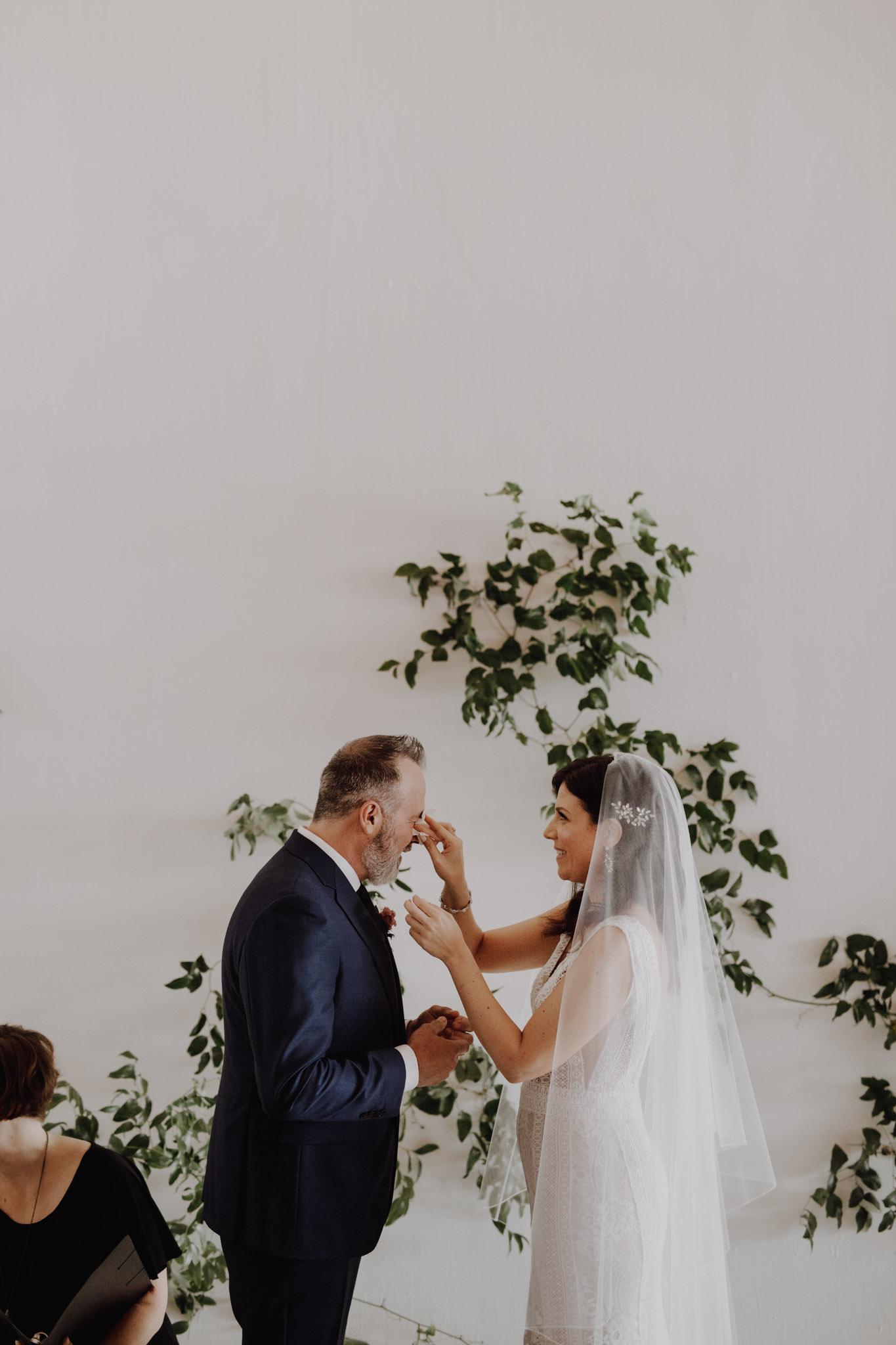 District 28 Wedding Toronto - Bride & groom wipe tears