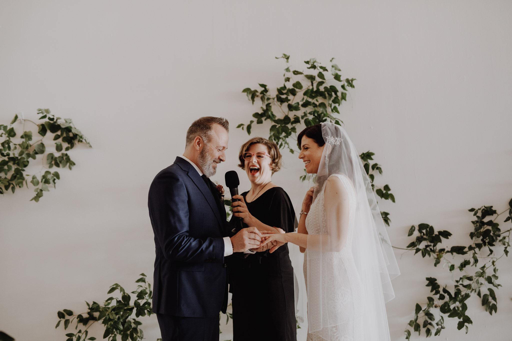 District 28 Wedding Toronto - exchanging vows