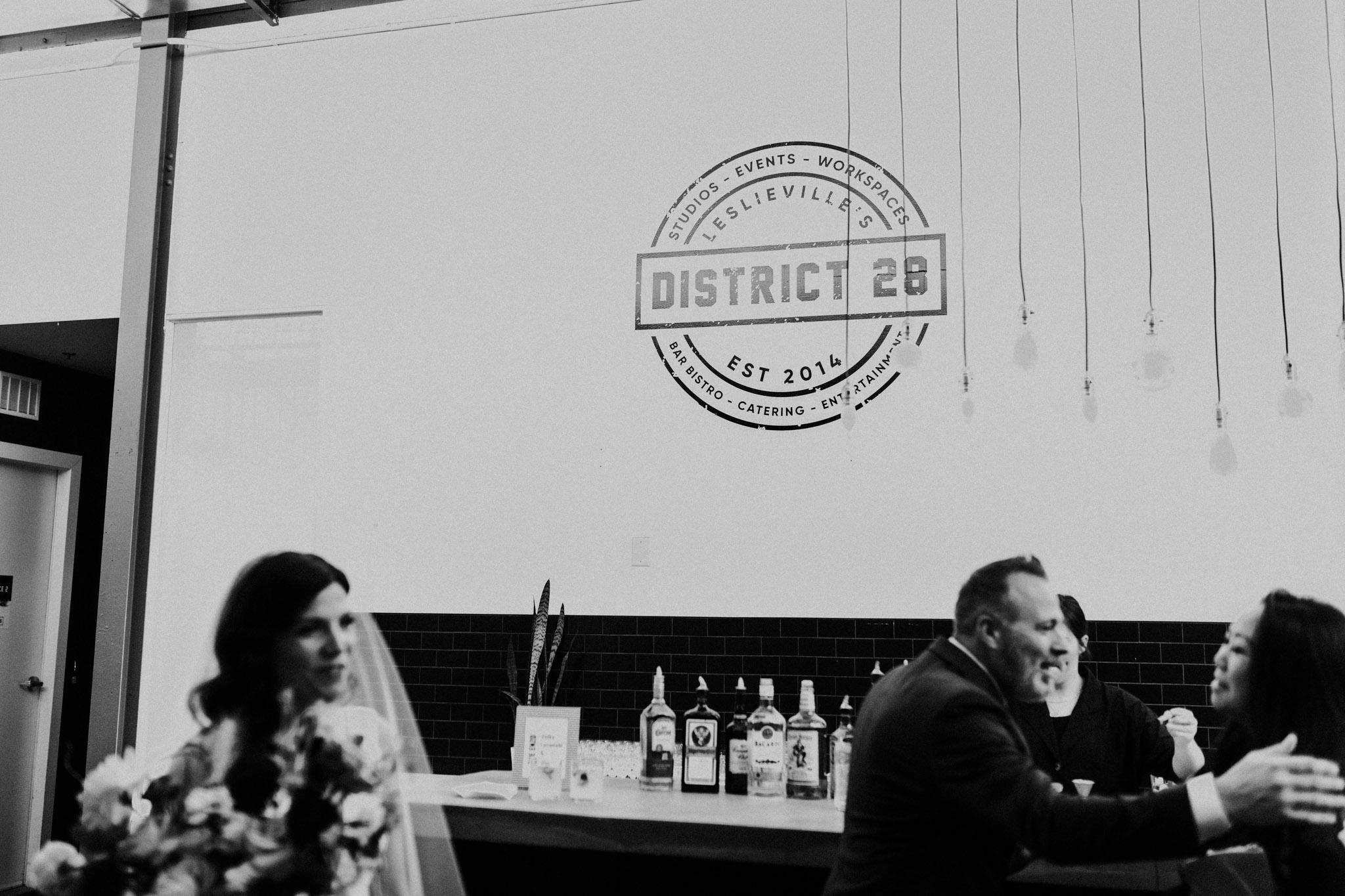 District 28 Wedding Toronto - Bride & groom at bar