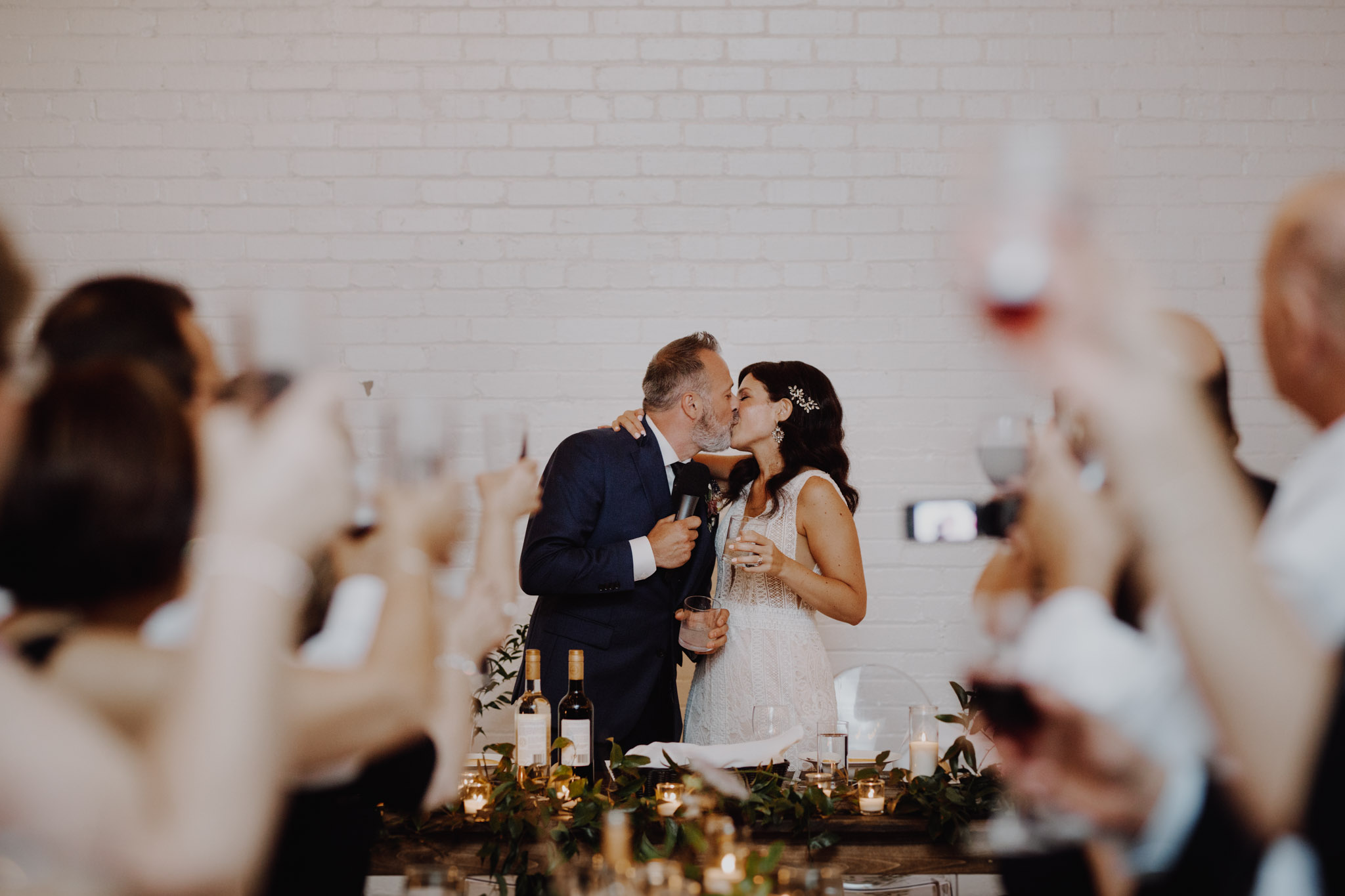 District 28 Wedding Toronto - kiss and cheers