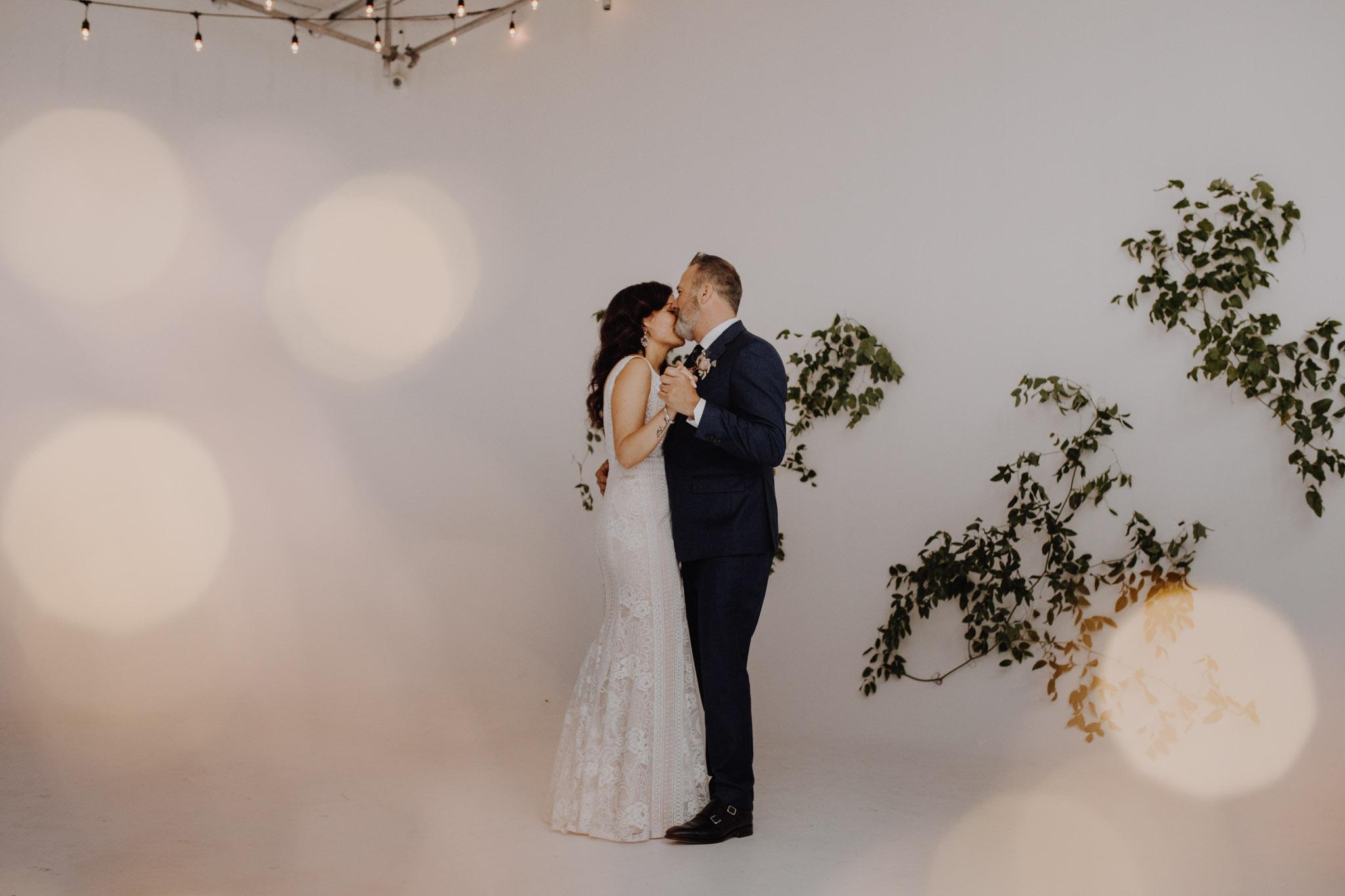 District 28 Wedding Toronto - first dance white backdrop