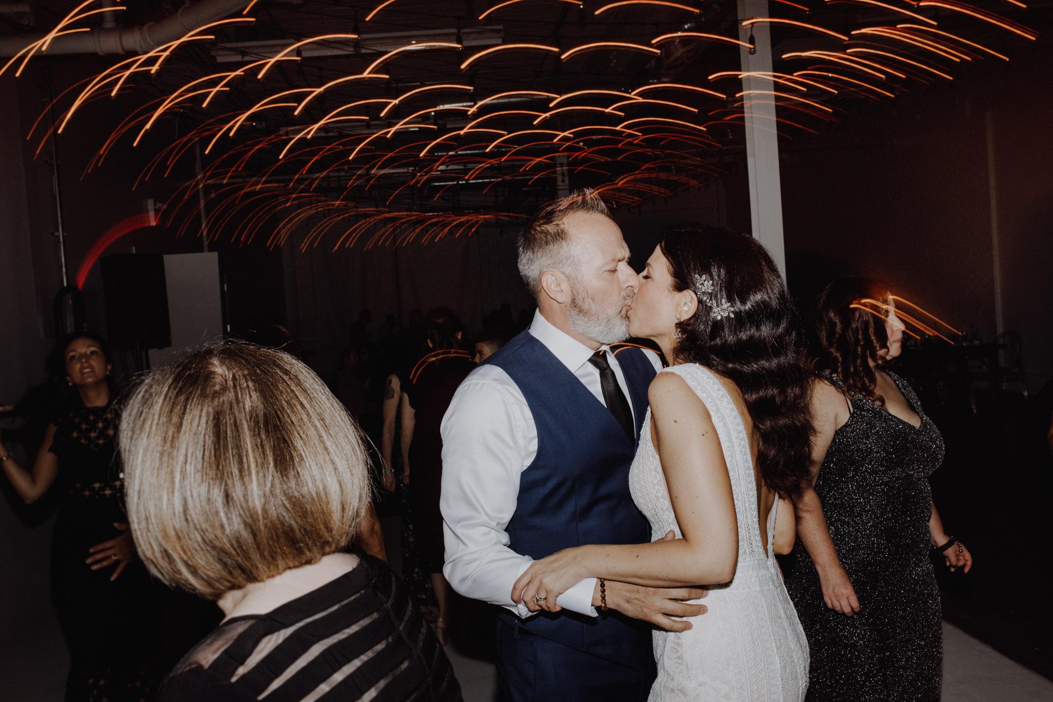District 28 Wedding Toronto - kissing on the dance floor