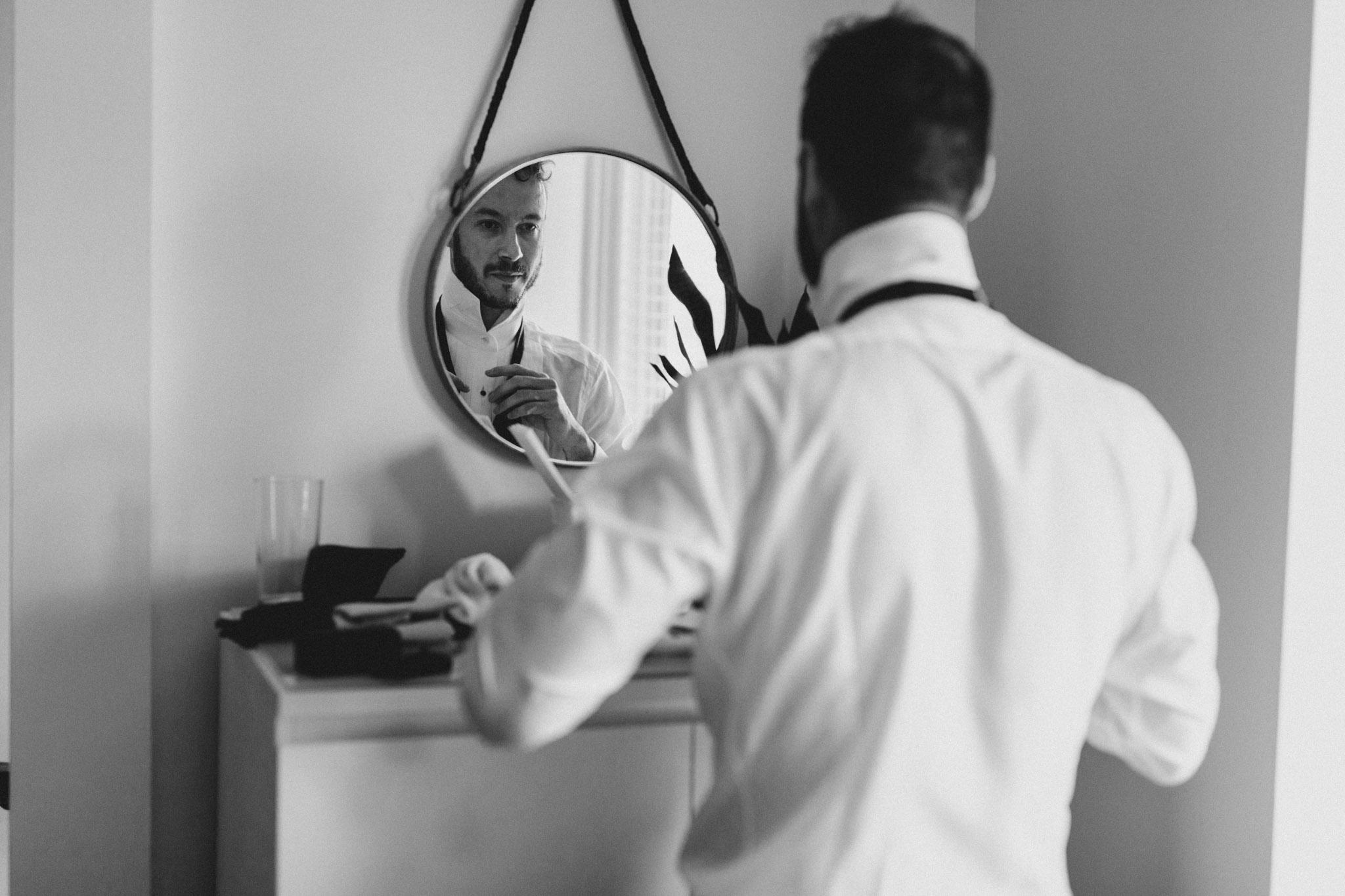 Casa La Palma Wedding - groom prepping in mirror