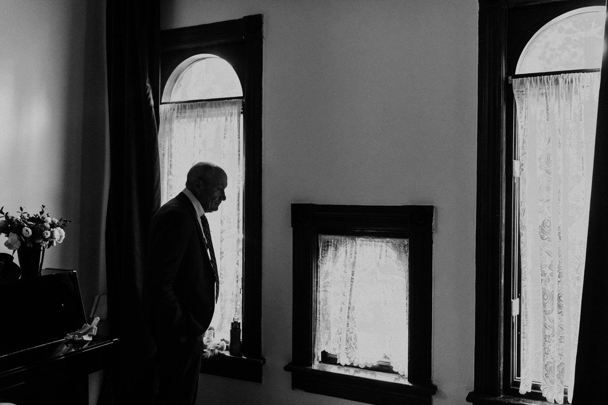 Casa La Palma Wedding - documentary wedding photography - silhouette of father in window