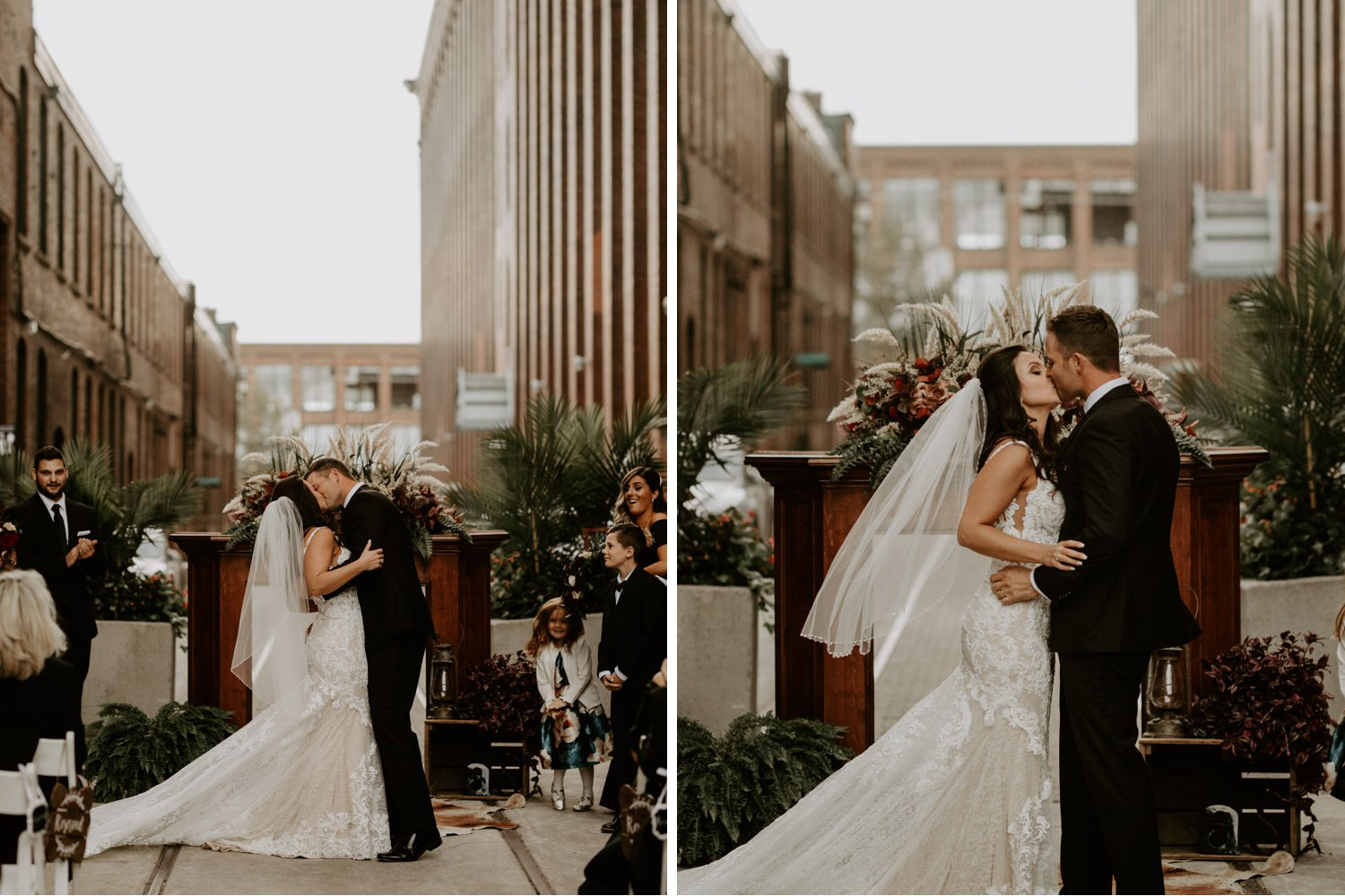 Liberty Village Wedding - first kiss as newlyweds during outdoor ceremony at Caffino