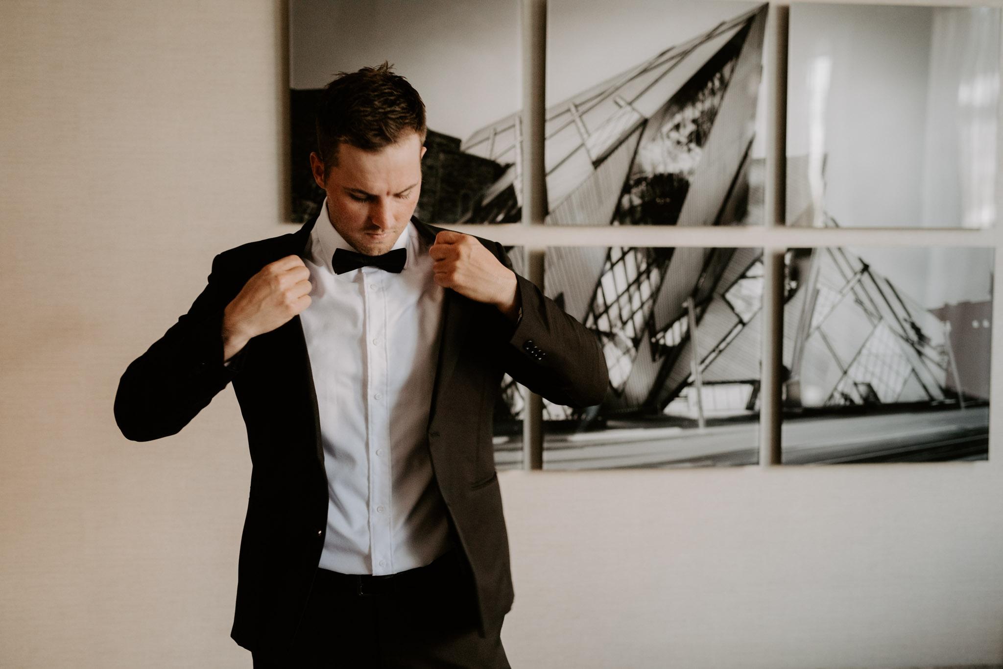 Liberty Village Wedding - groom putting on jacket