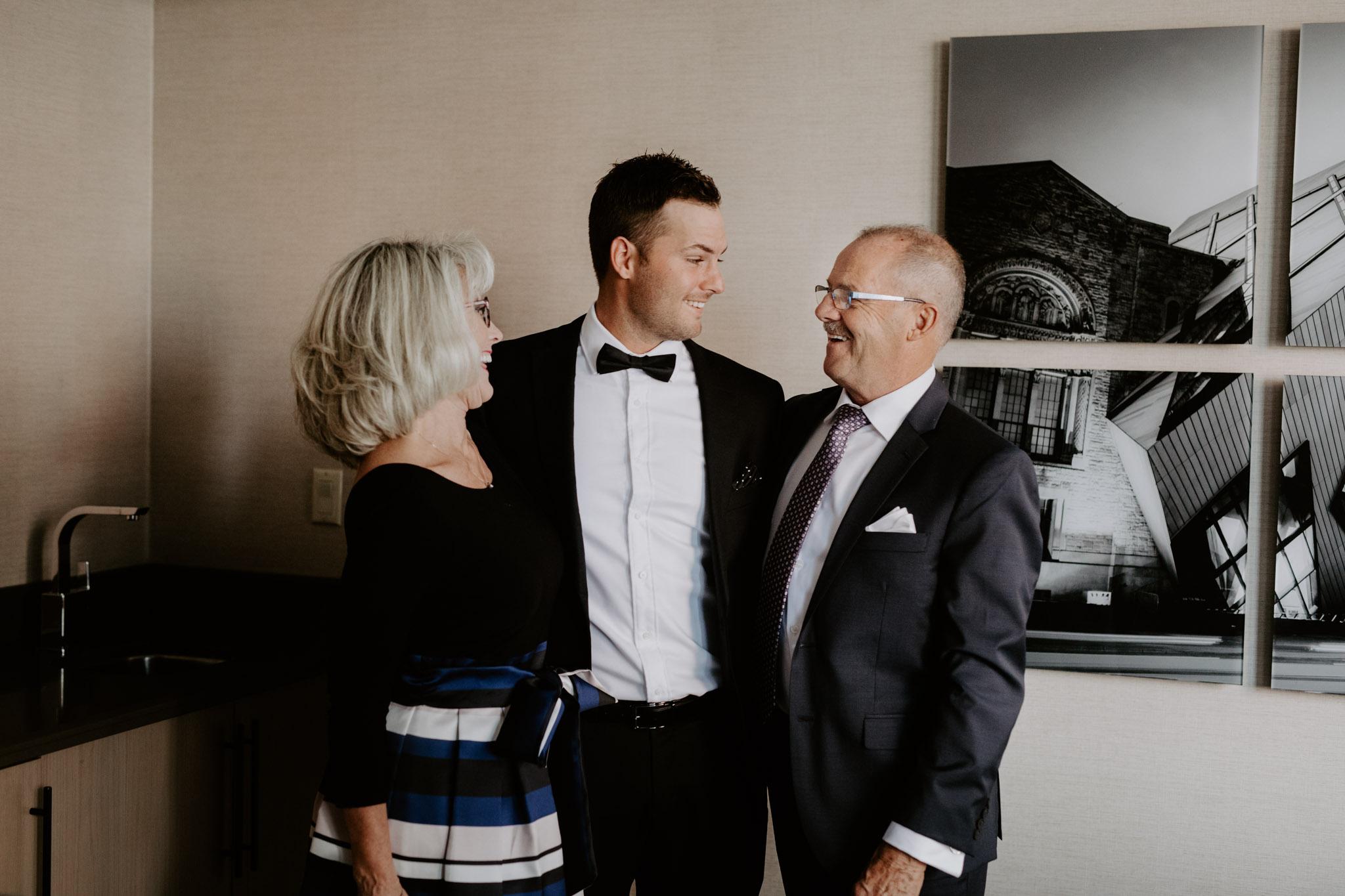 Liberty Village Wedding - groom hugging parents