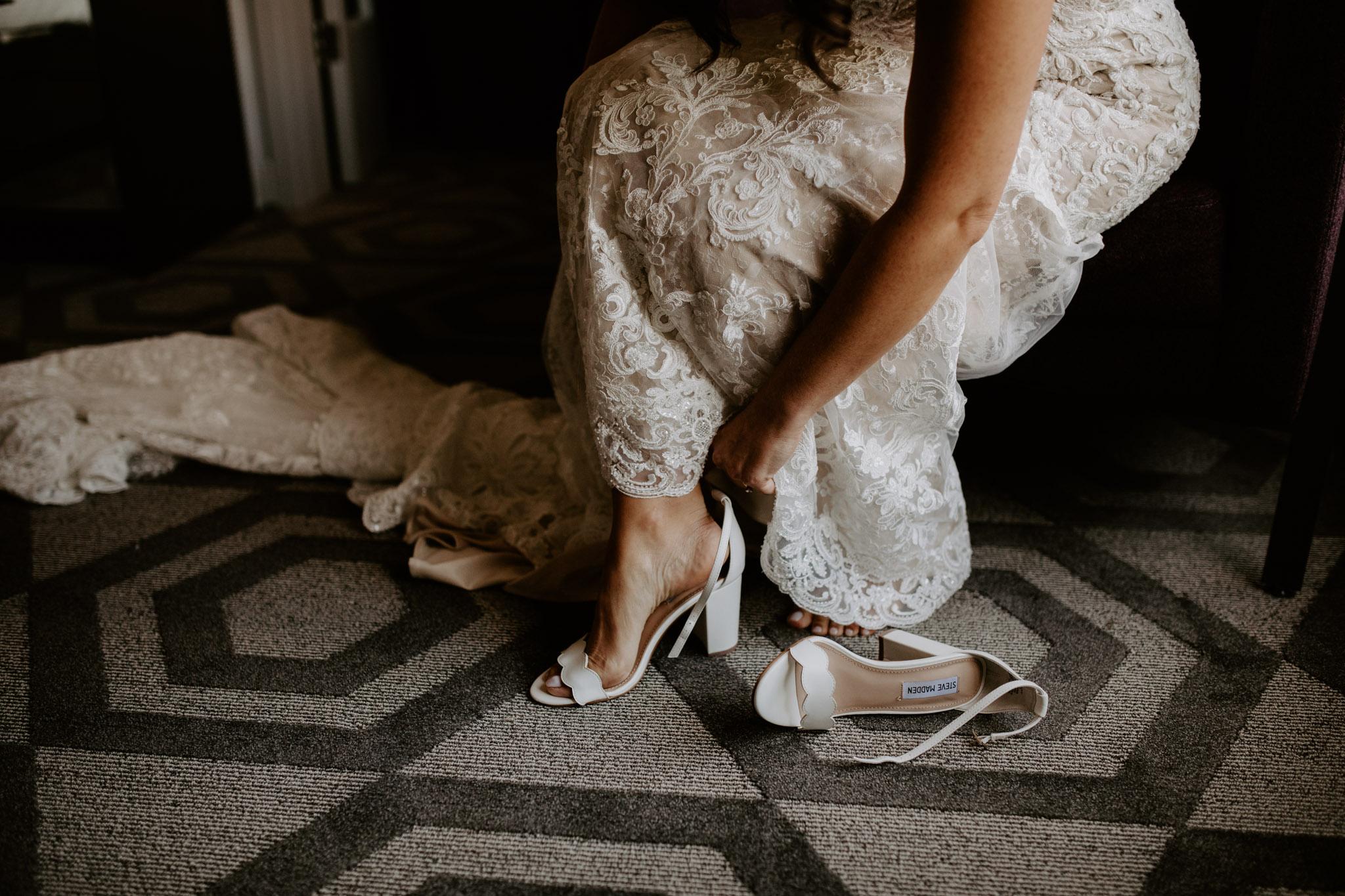 Liberty Village Wedding - bride putting shoes on