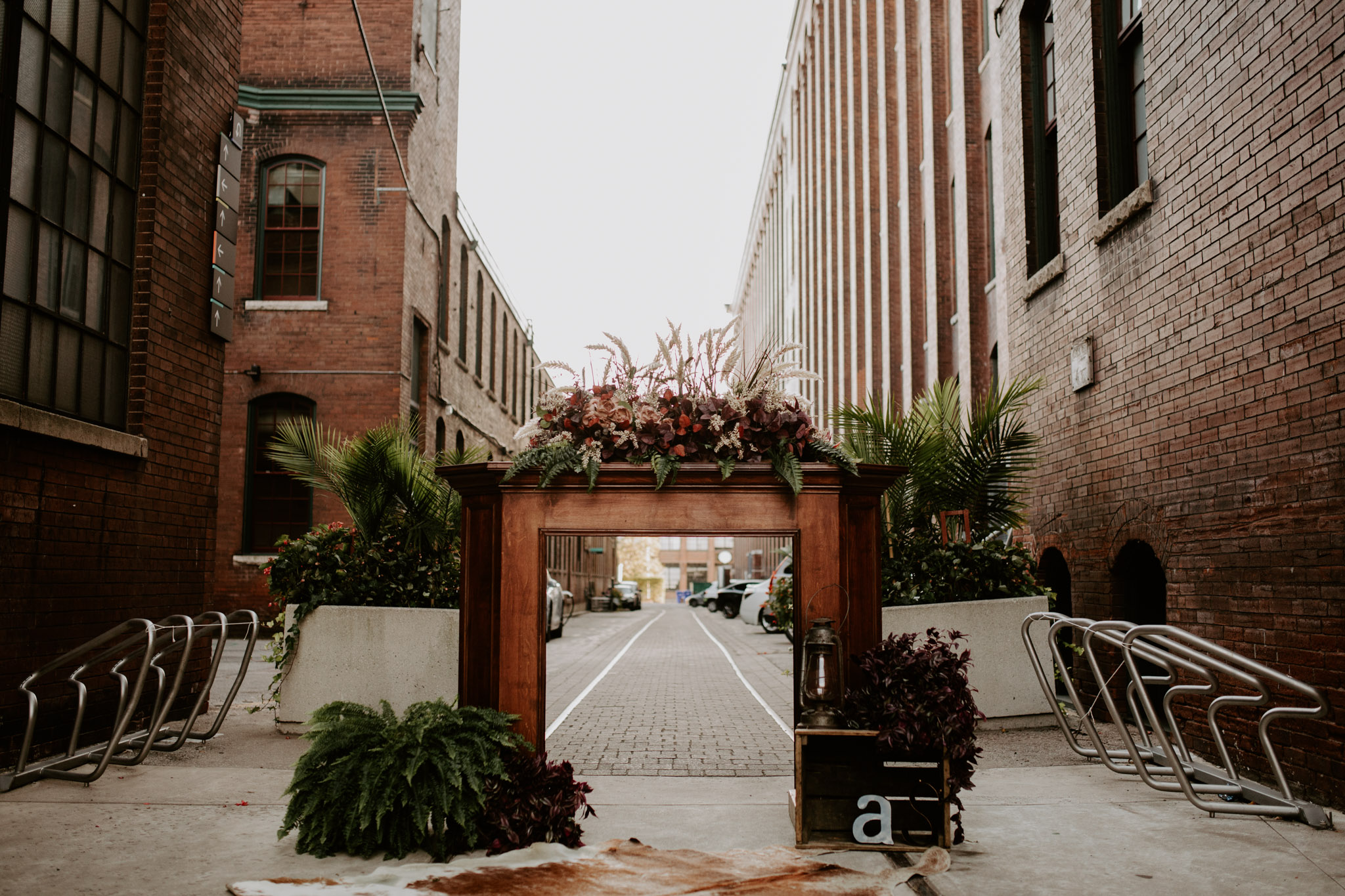 Liberty Village Wedding - Outdoor alter with fireplace and wreath