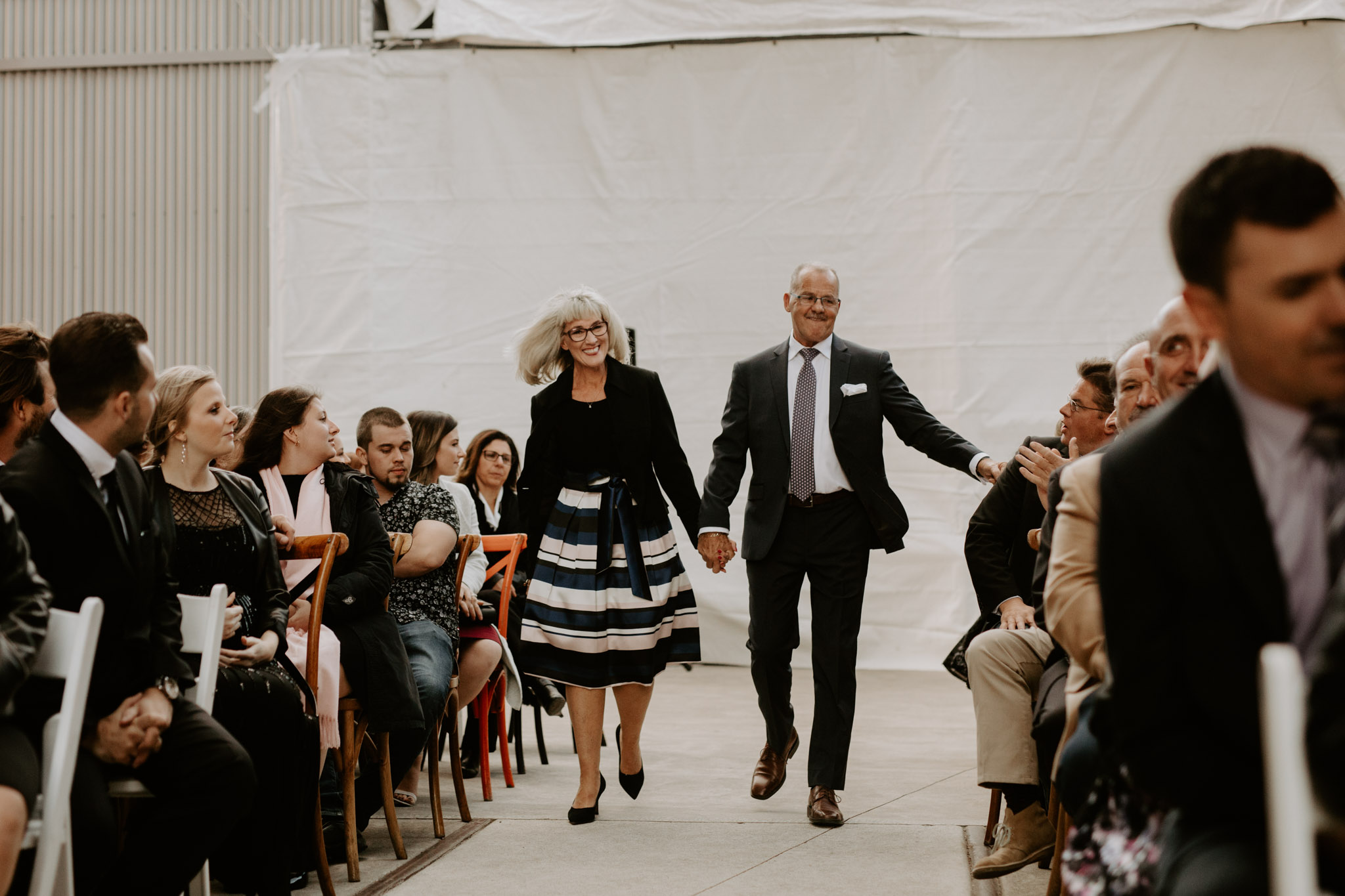 Liberty Village Wedding - groom's parents walk down the aisle