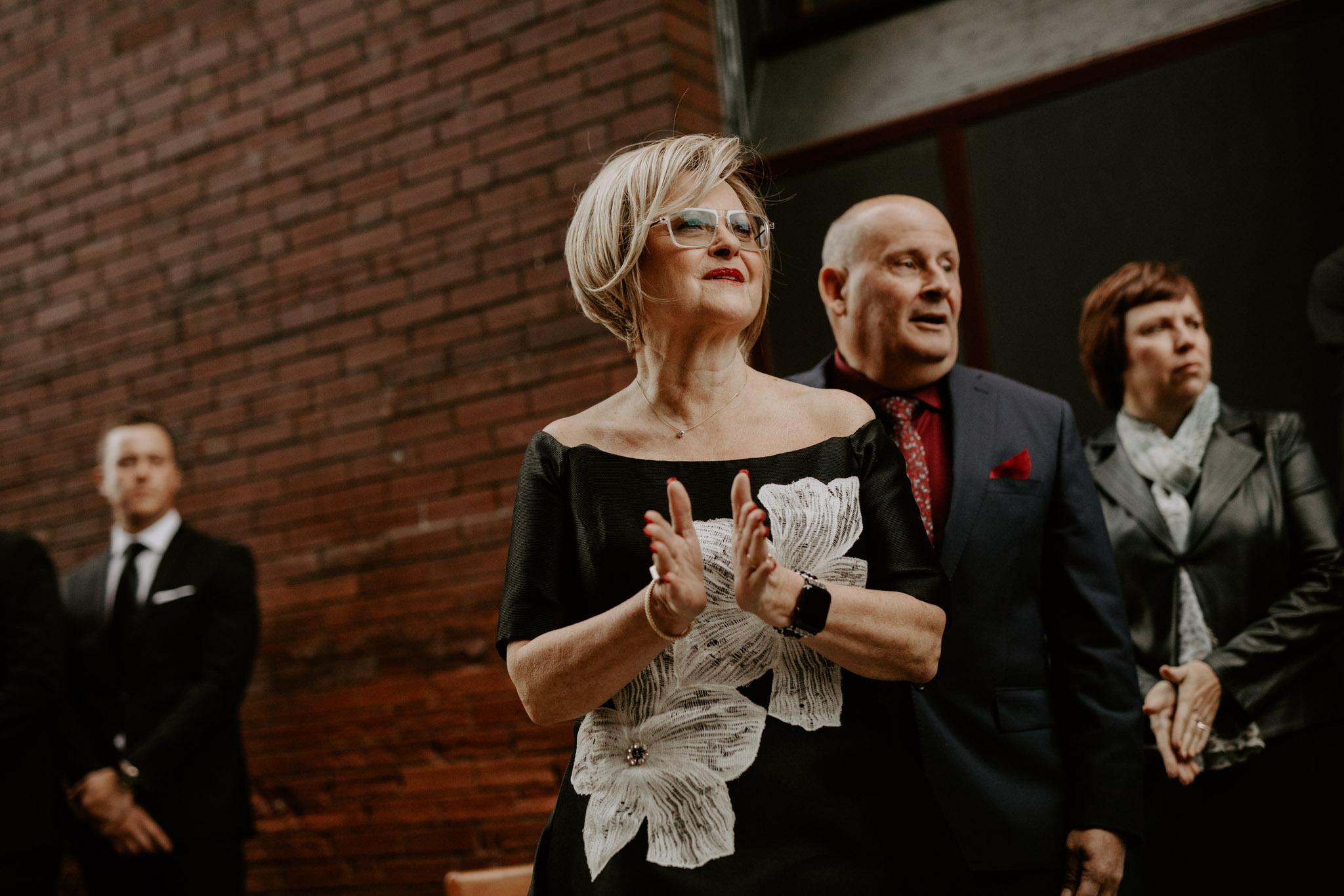 Liberty Village Wedding - bride's mom clapping