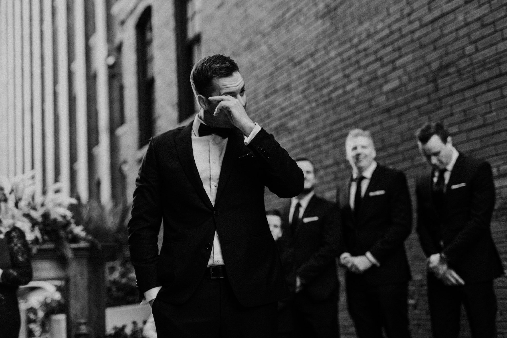 Liberty Village Wedding - groom crying after seeing bride
