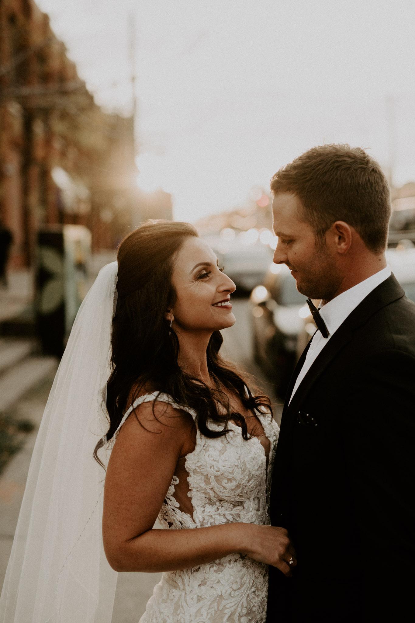 Liberty Village Wedding - Newlyweds back-lit at sunset