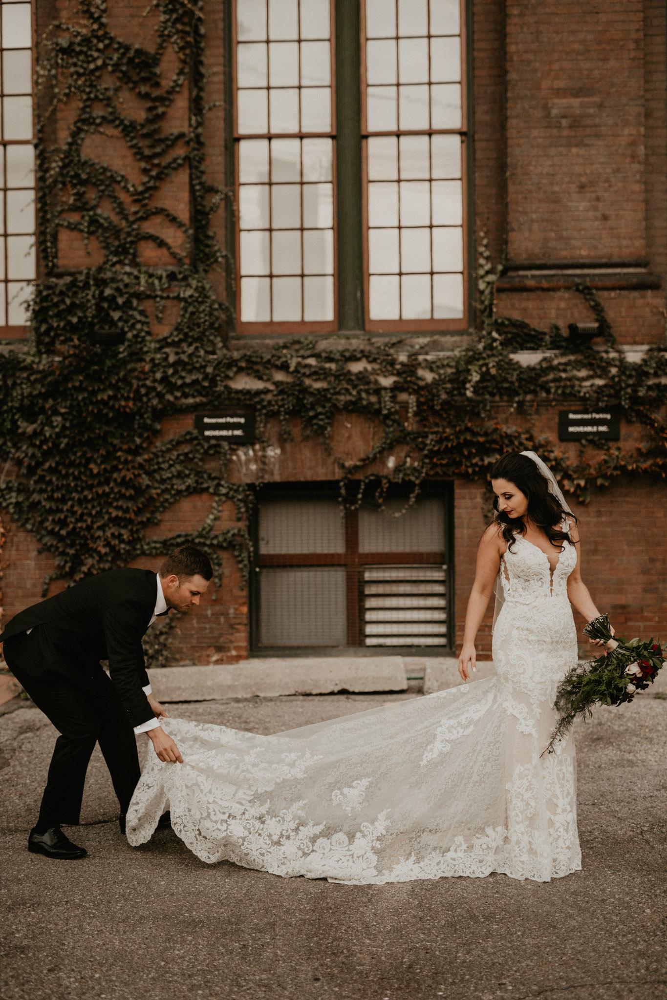 Liberty Village Wedding - groom fixes brides train