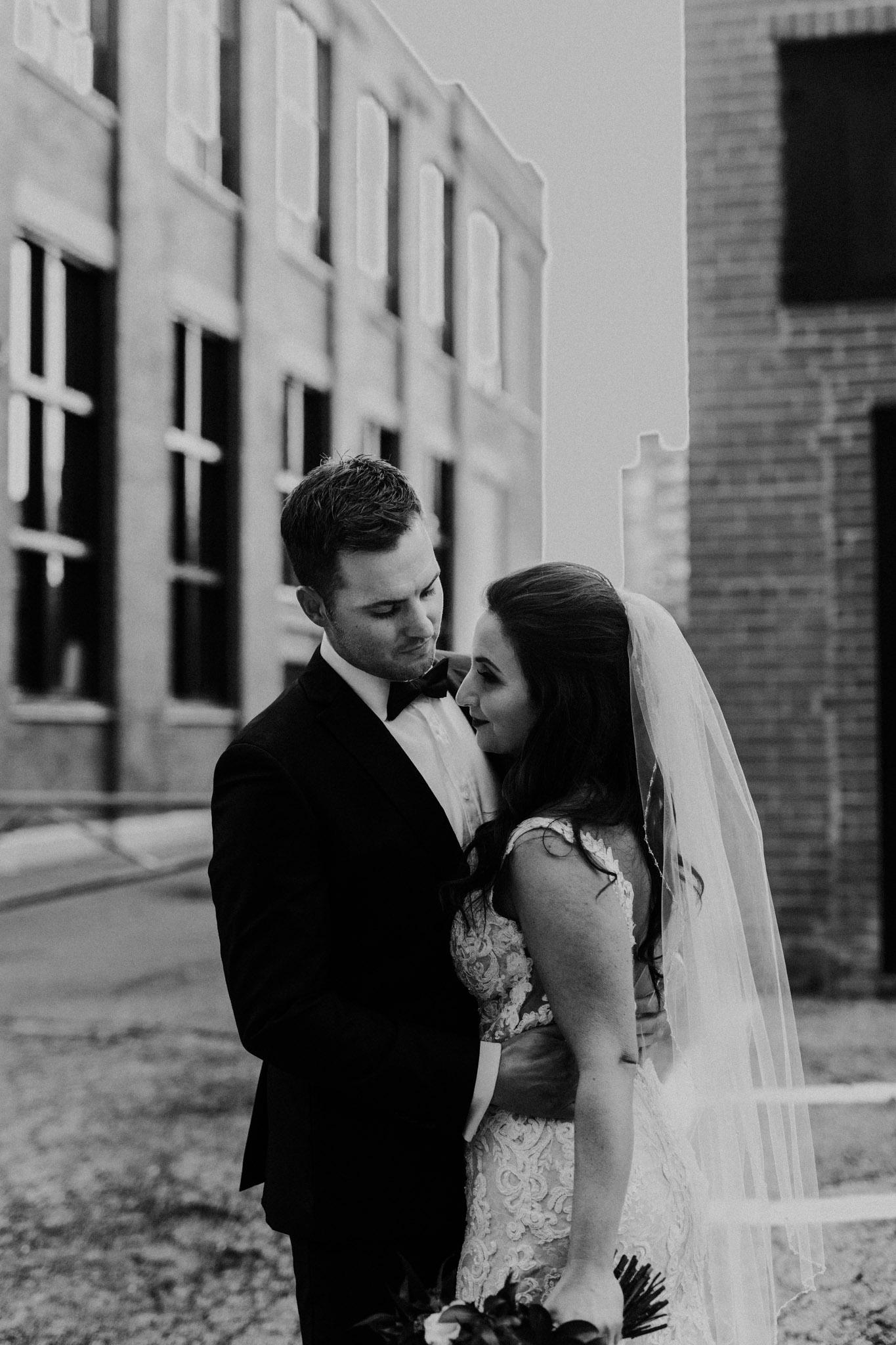 Liberty Village Wedding - Black and white photo of newlyweds embracing