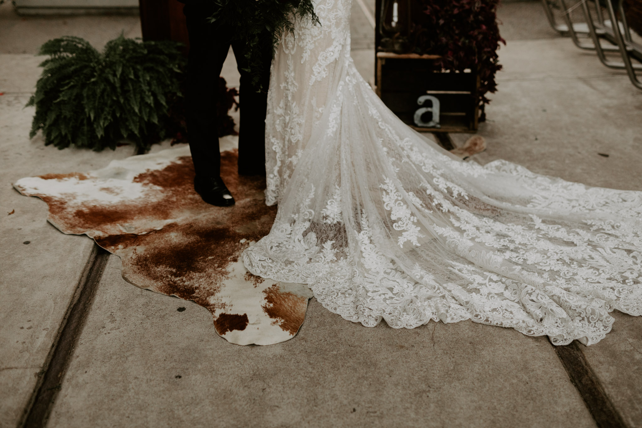 Caffino wedding - bride and groom'stand on hide rug at outdoor alter