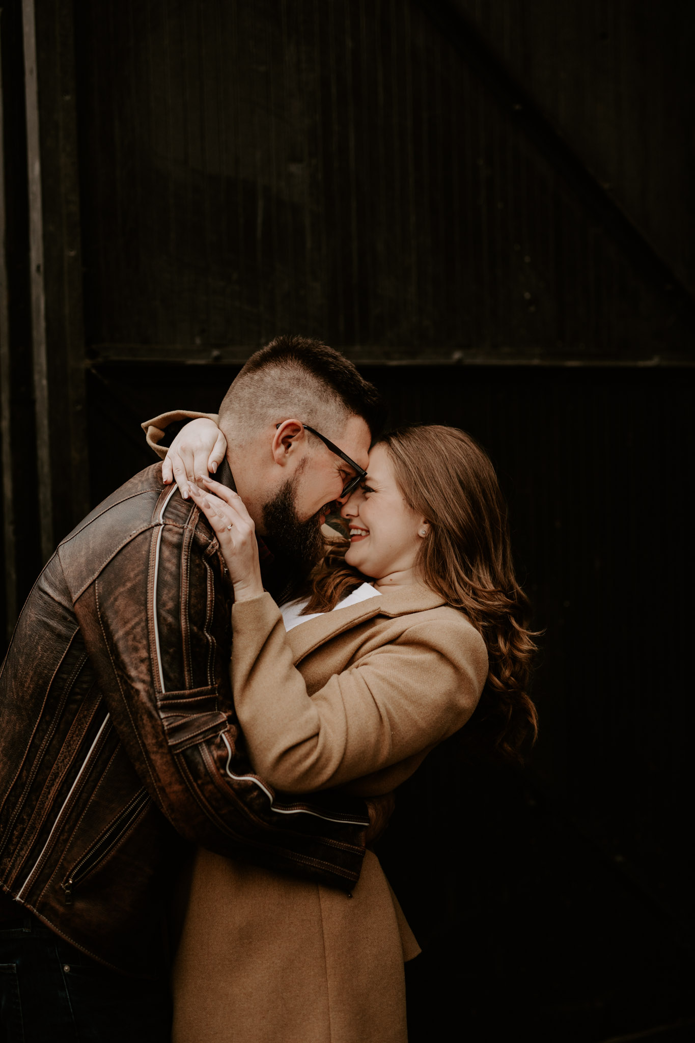 SteamWhistle Brewery Engagement - couple embrace while laughing