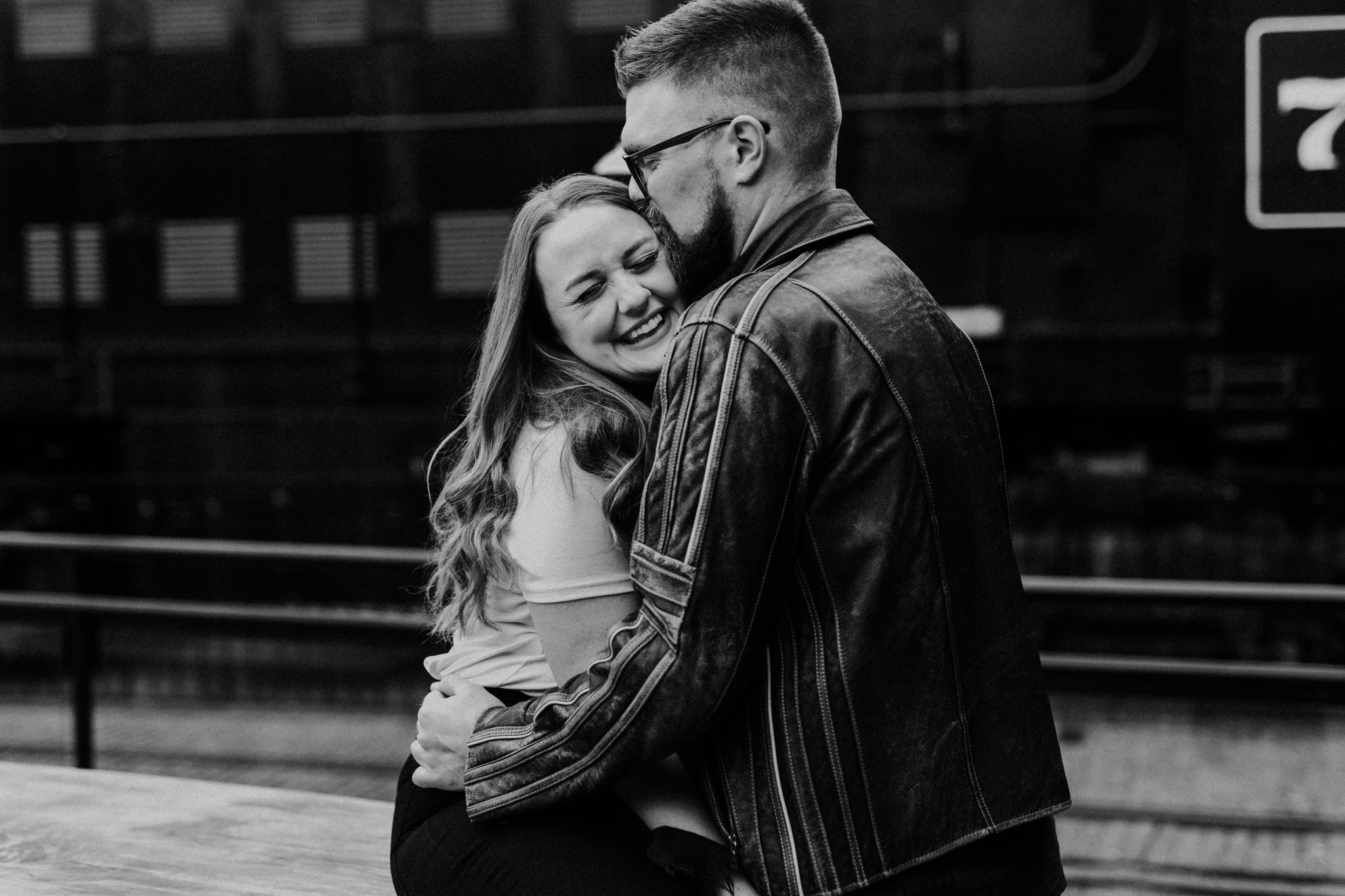 SteamWhistle Brewery Engagement - silly hugs outside