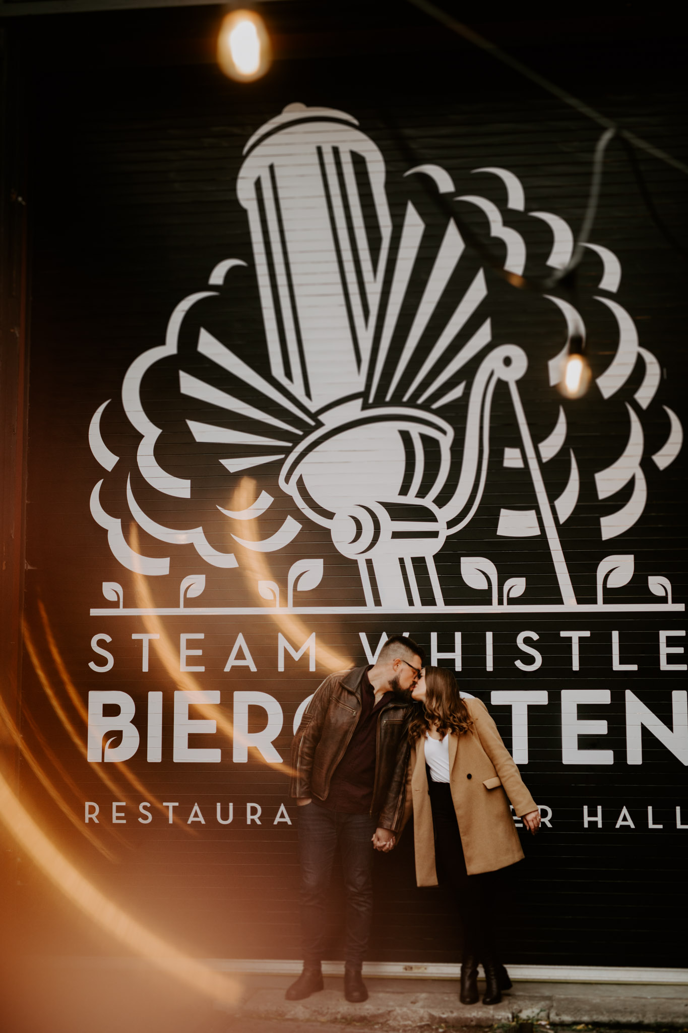 SteamWhistle Brewery Engagement - Kissing couple with lens flare