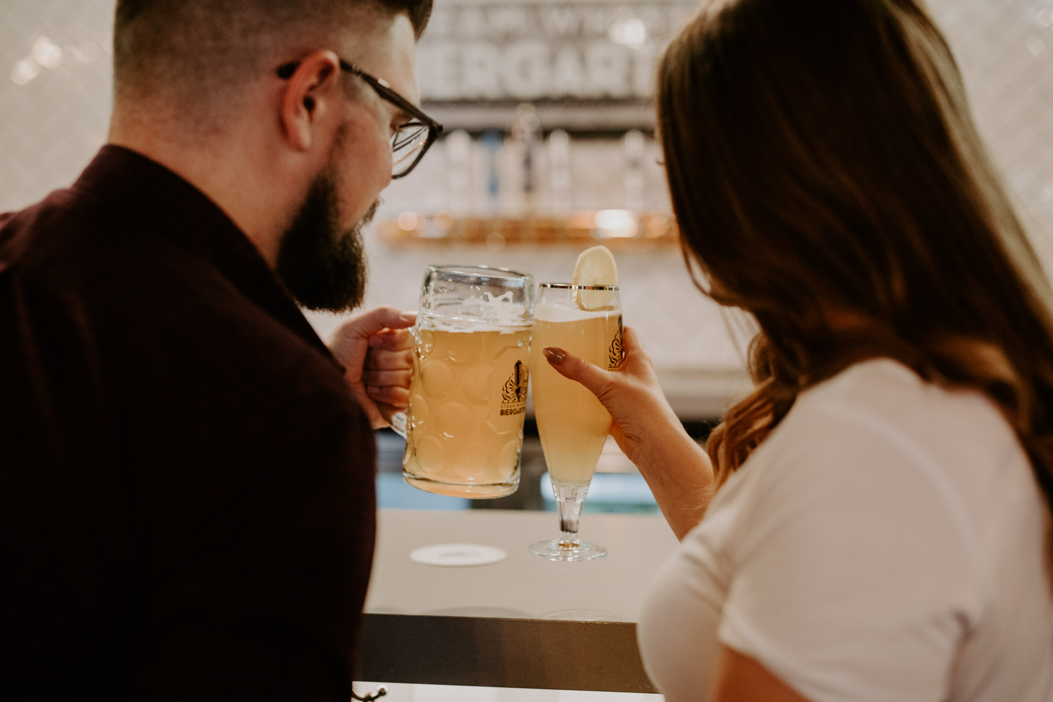 SteamWhistle Brewery Engagement - couple cheers with beer